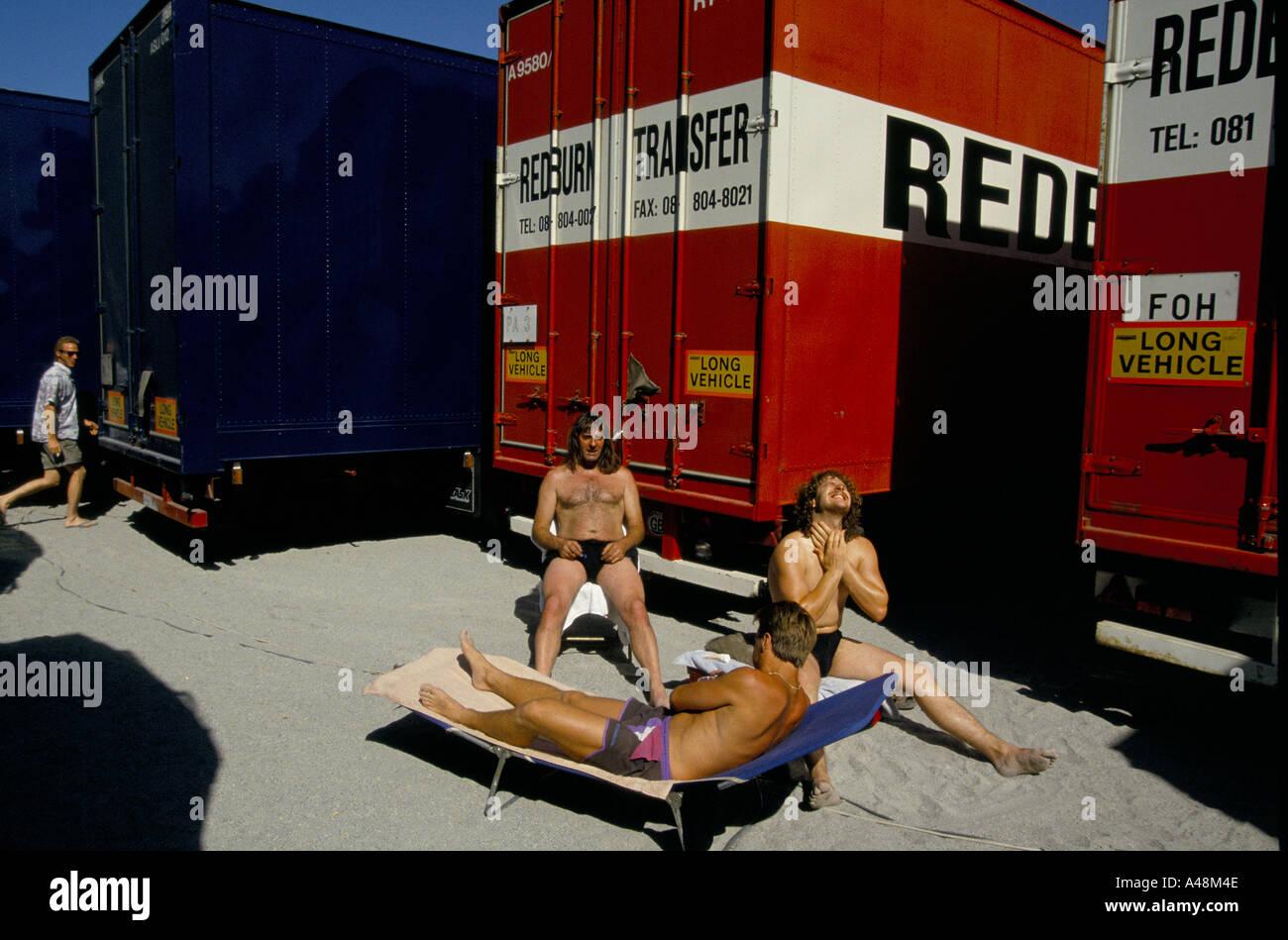 Roadies for U2 sunbathing during the zooropa tour of europe - Stock Image