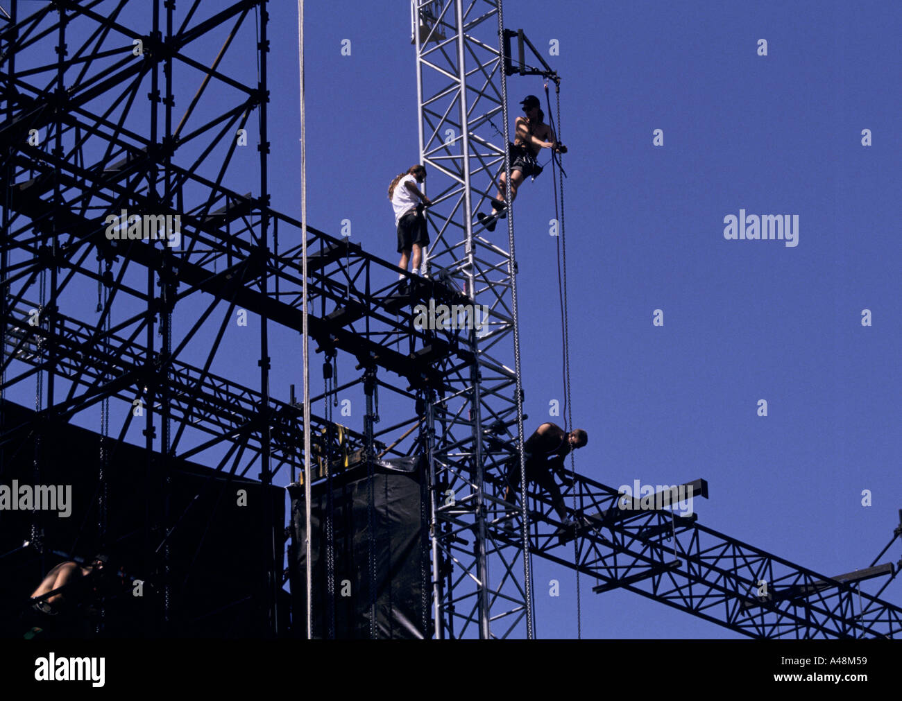 Roadies or riggers building up the stage set for a concert by Irish rock band U2 concert in Geneva Switzerland - Stock Image