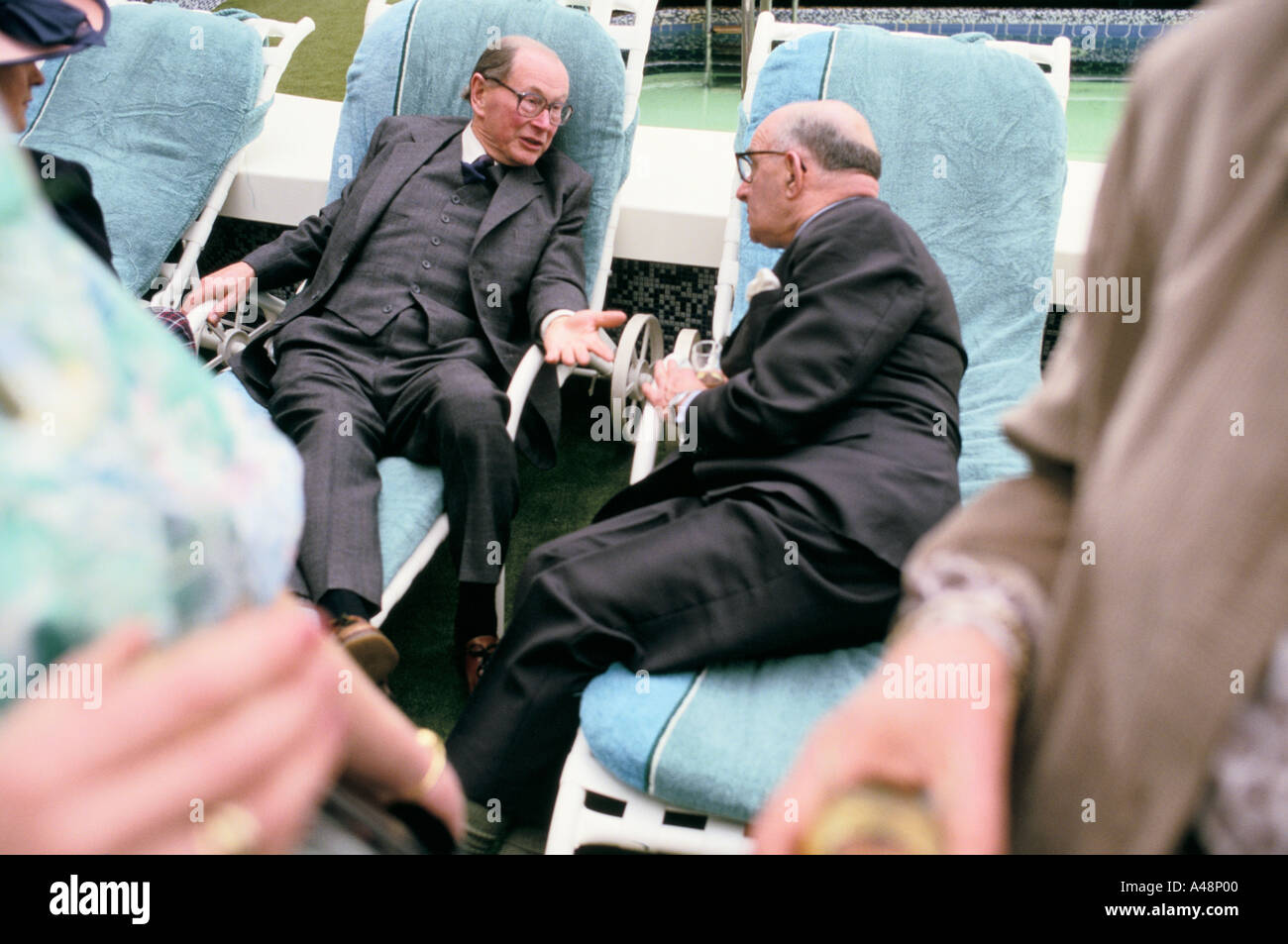 Two passenger talking earnestly at the start of The QE2  anniversary cruise across the atlantic - Stock Image