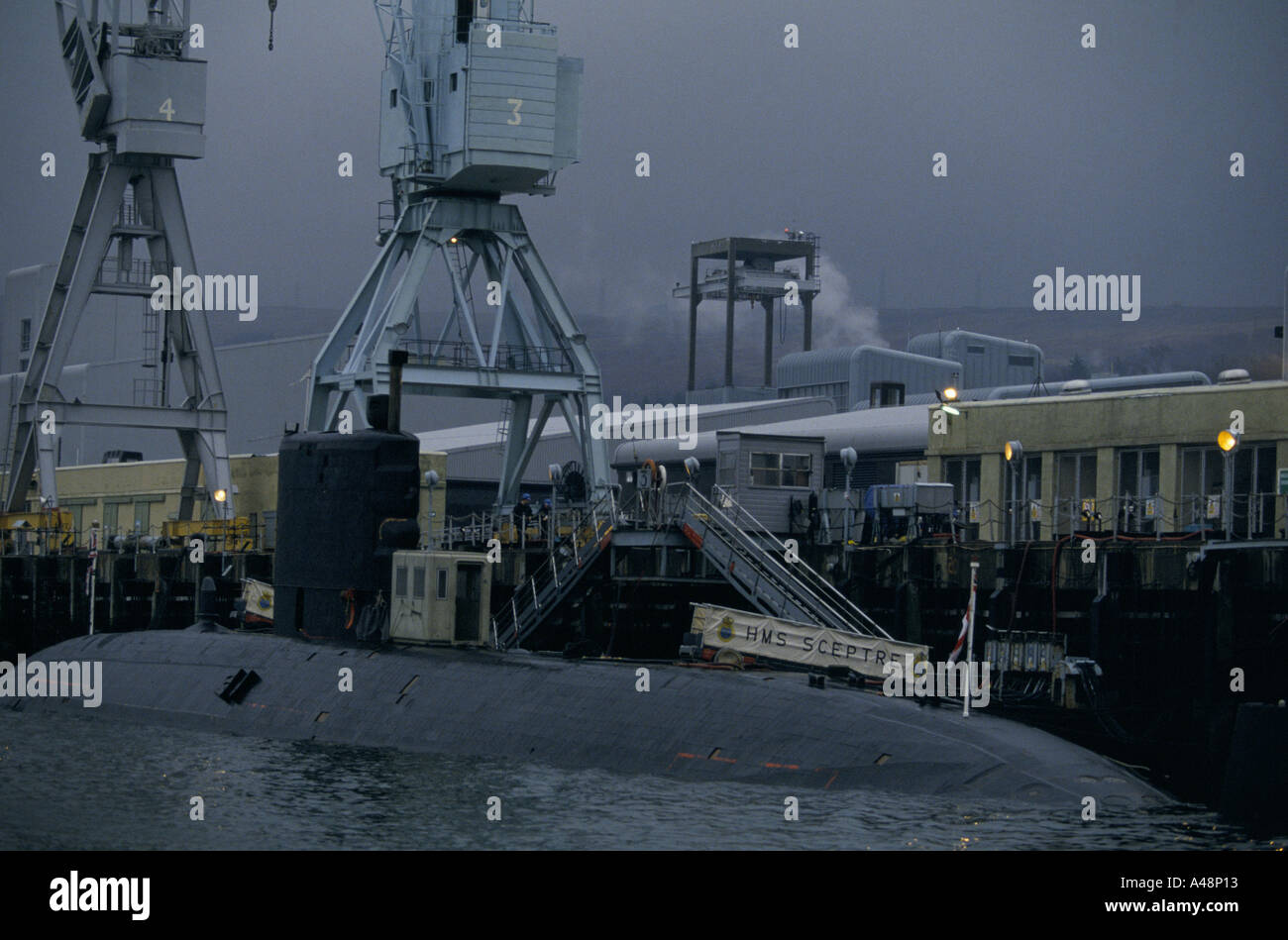 top part of submarine hms septre exposed on water faslane naval base river clyde - Stock Image