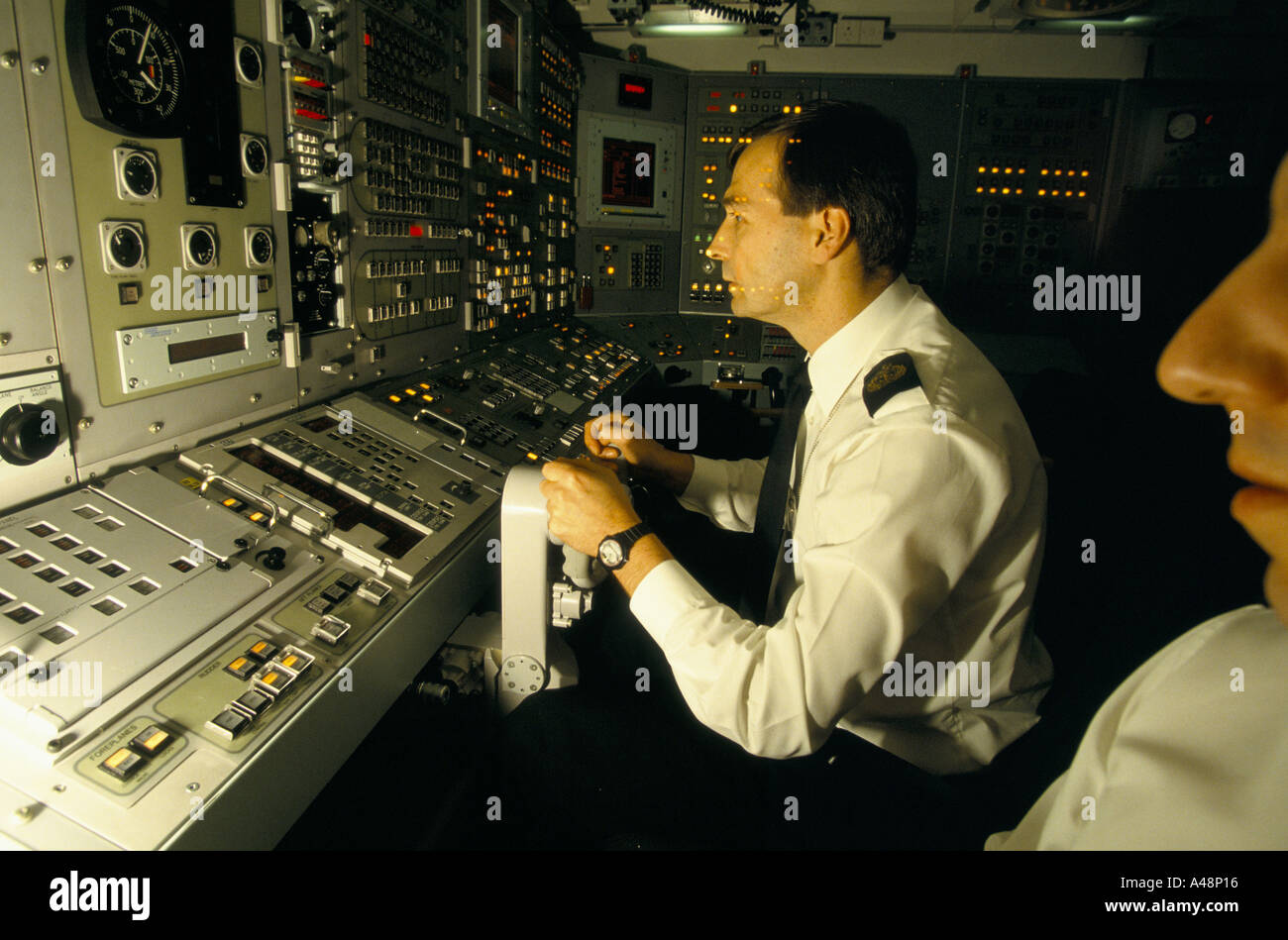faslane naval base officers on control board of trident nuclear armed submarine - Stock Image