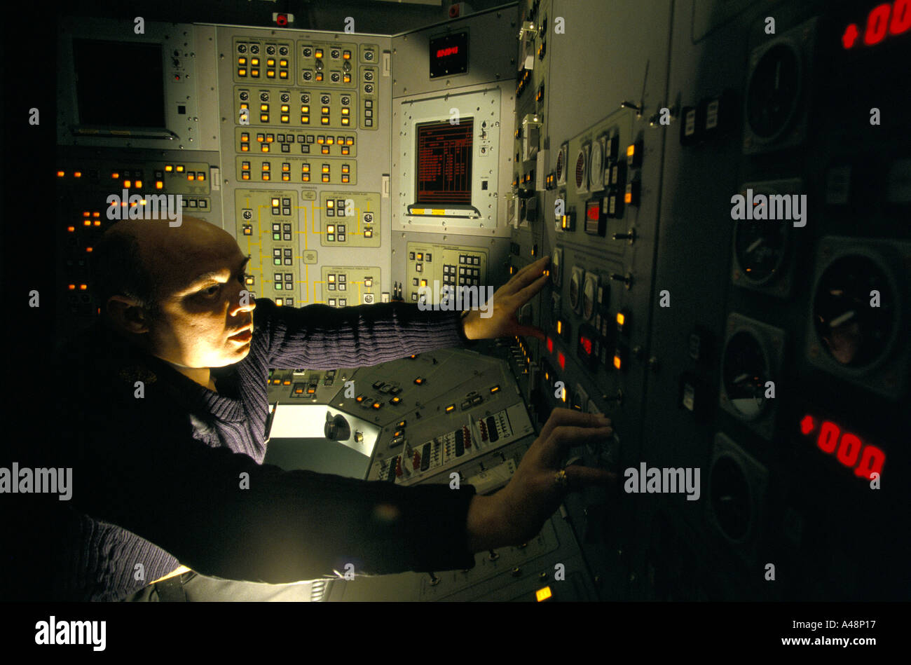 faslane naval base officer at control panel of trident nuclear armed submarine - Stock Image