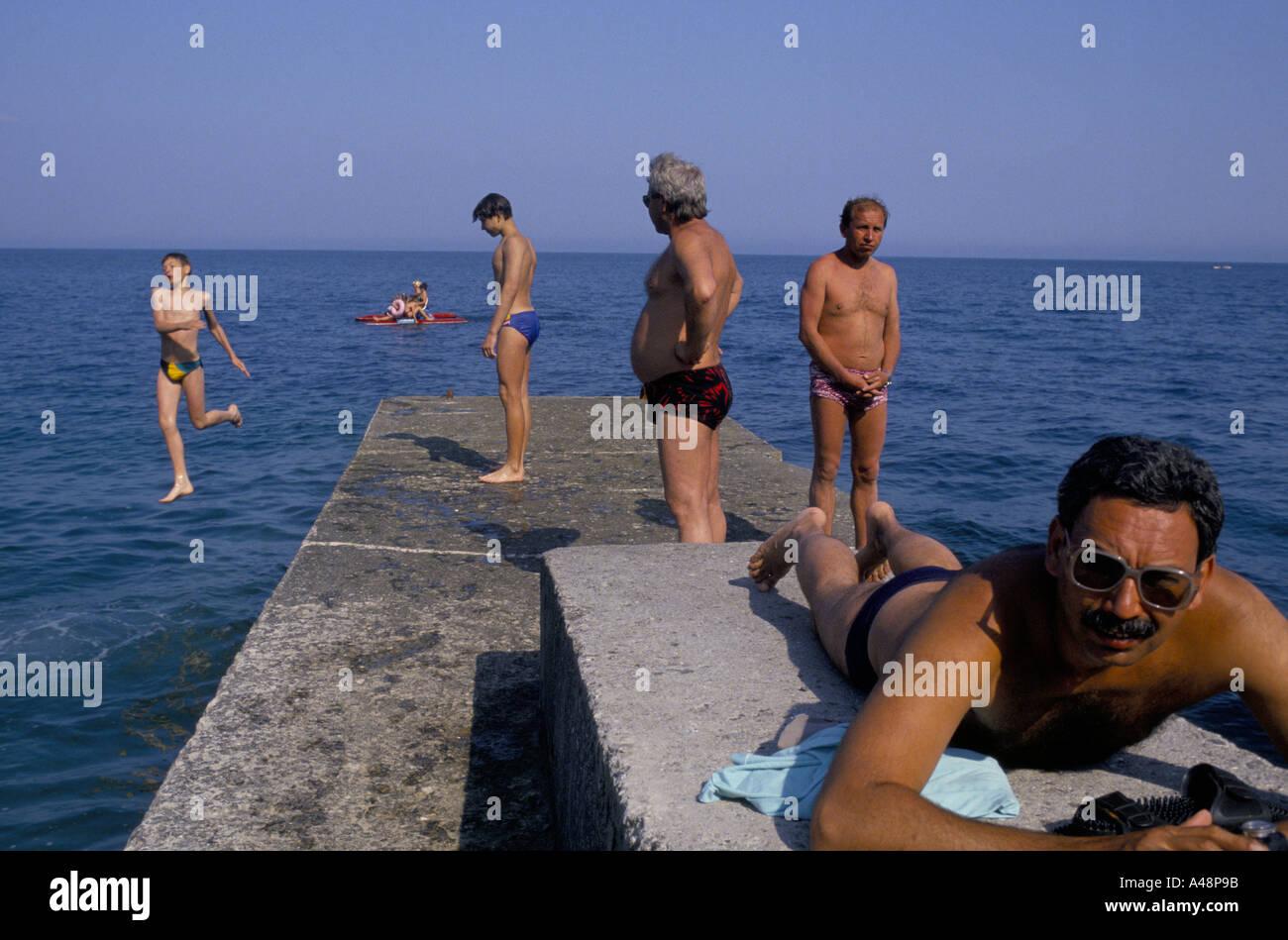 Holidaymakers sunbathing on Yalta beach crimea ukraine - Stock Image