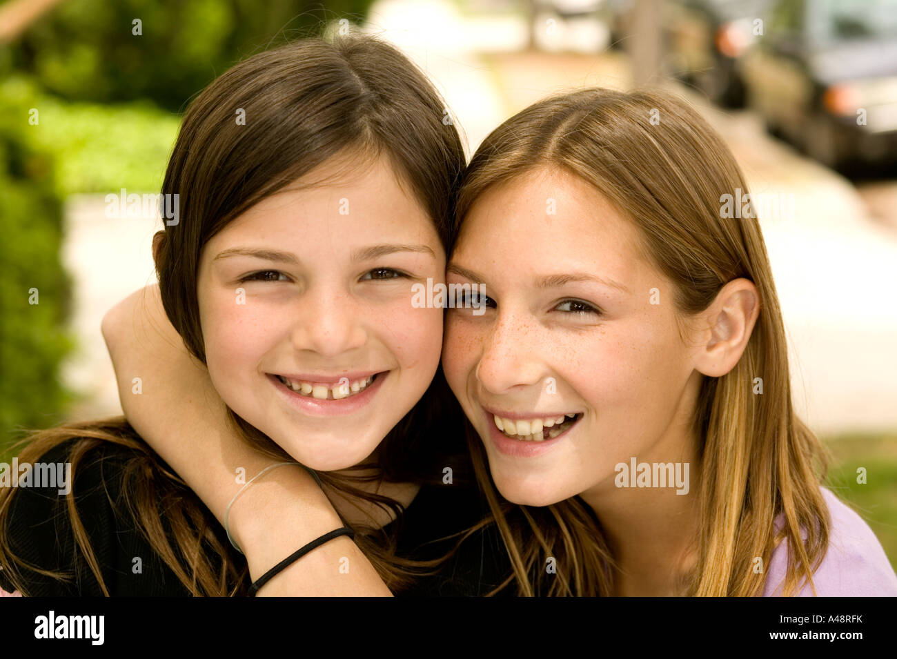 Girl embracing sister, smiling, portrait Stock Photo