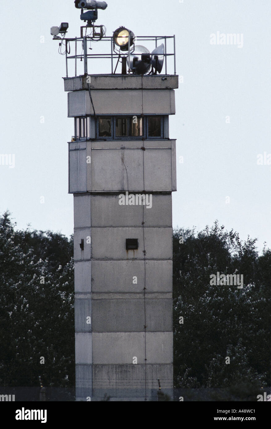 iron curtain north to south concrete ddr observation tower with camera surveillance equipment on top 1989 - Stock Image