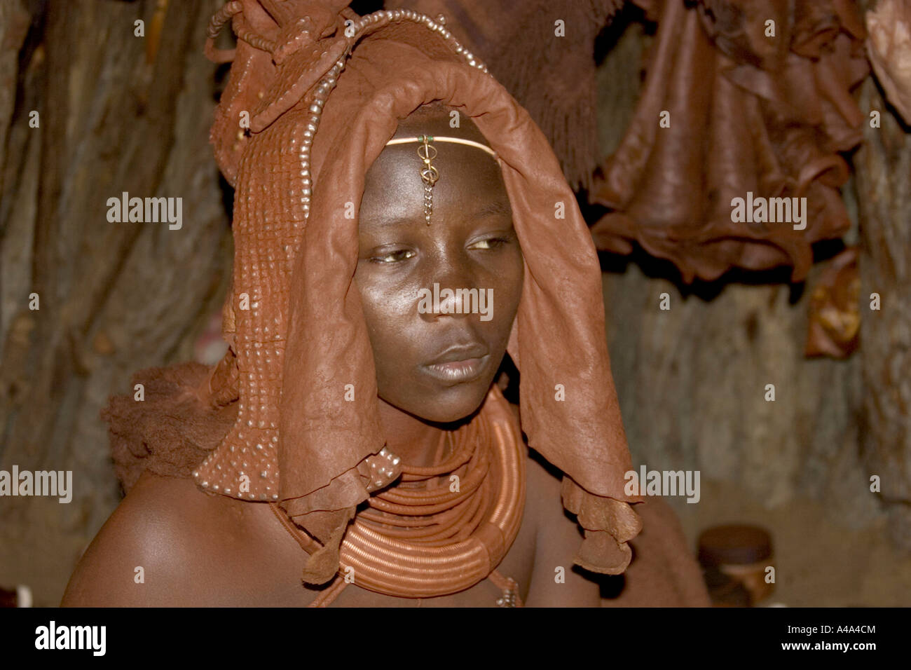 Himba woman with head decoration for mariage, Namibia - Stock Image