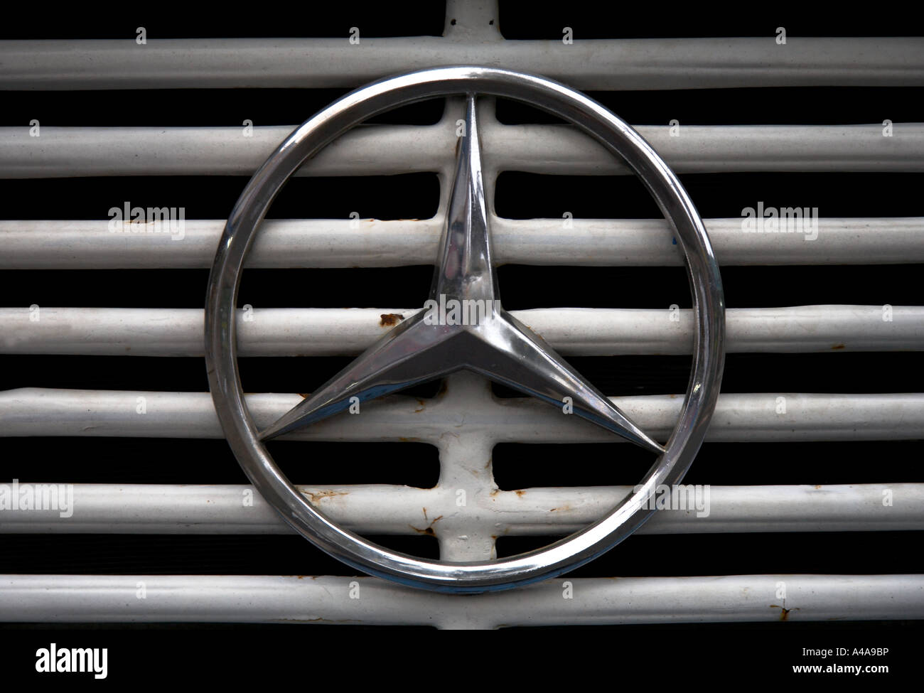 mercedes badge on grill of car - Stock Image