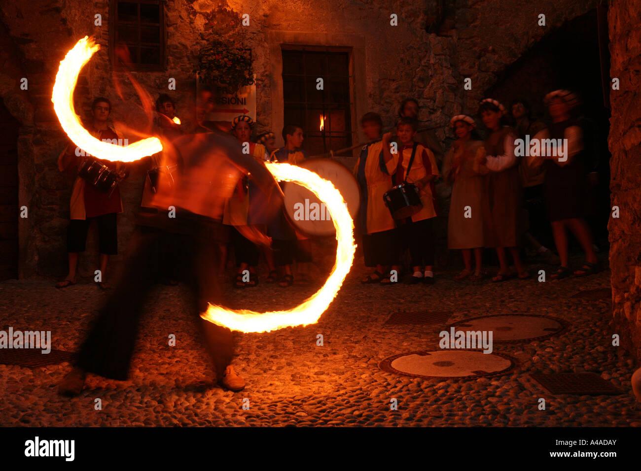 Entertainment with fire during Rustico Medioevo manifestation Canale di Tenno Trentino Alto Adige Italy - Stock Image