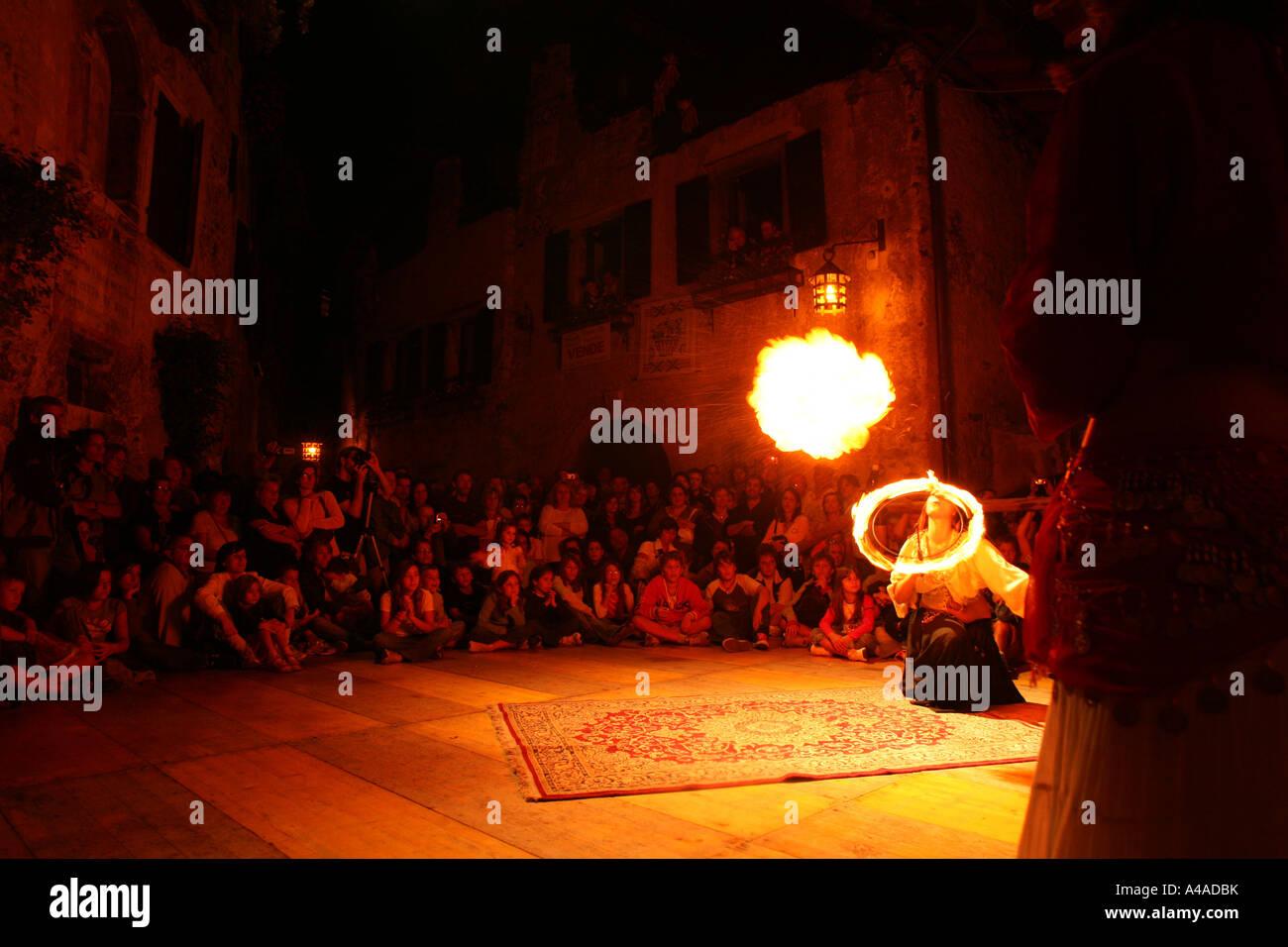 Enterttainment with fire during Rustico Medioevo manifestation Canale di Tenno Trentino Alto Adige Italy - Stock Image