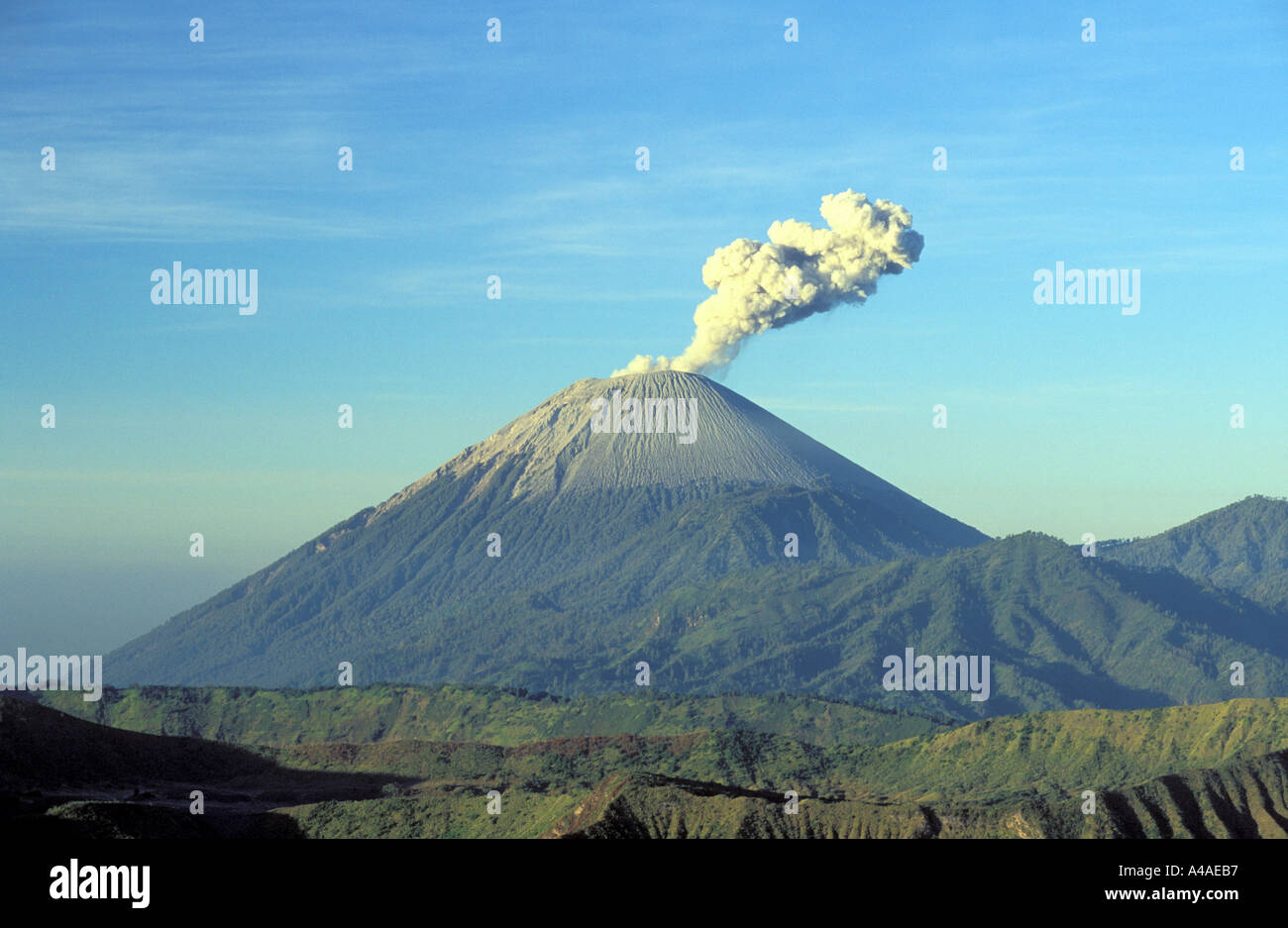 Mount Semeru expelling steam on the island of Java in Indonesia Southeast Asia - Stock Image