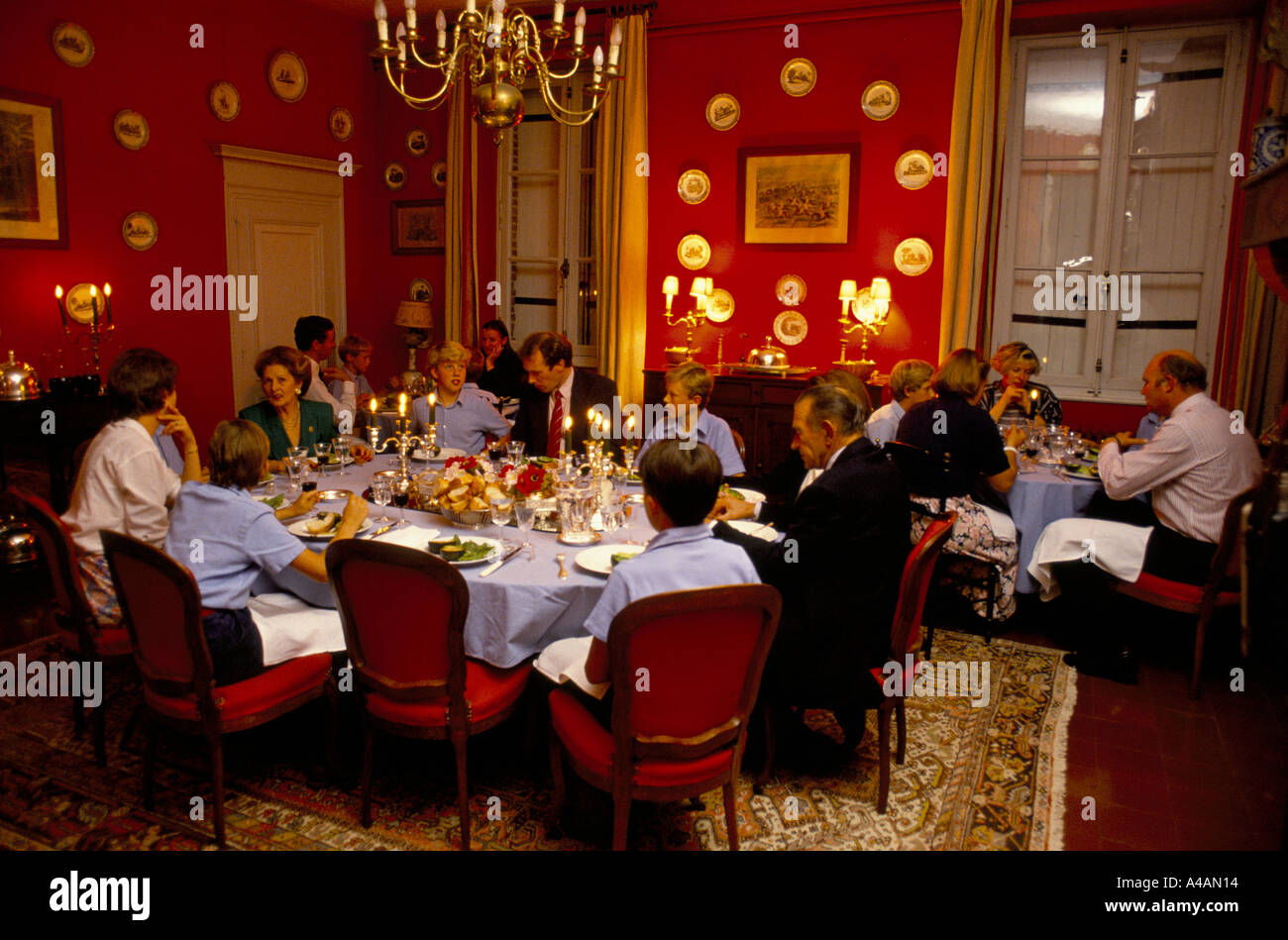 Teachers and pupils eat supper. The school has an annex at Saveterre Chateau near Toulouse, France - Stock Image