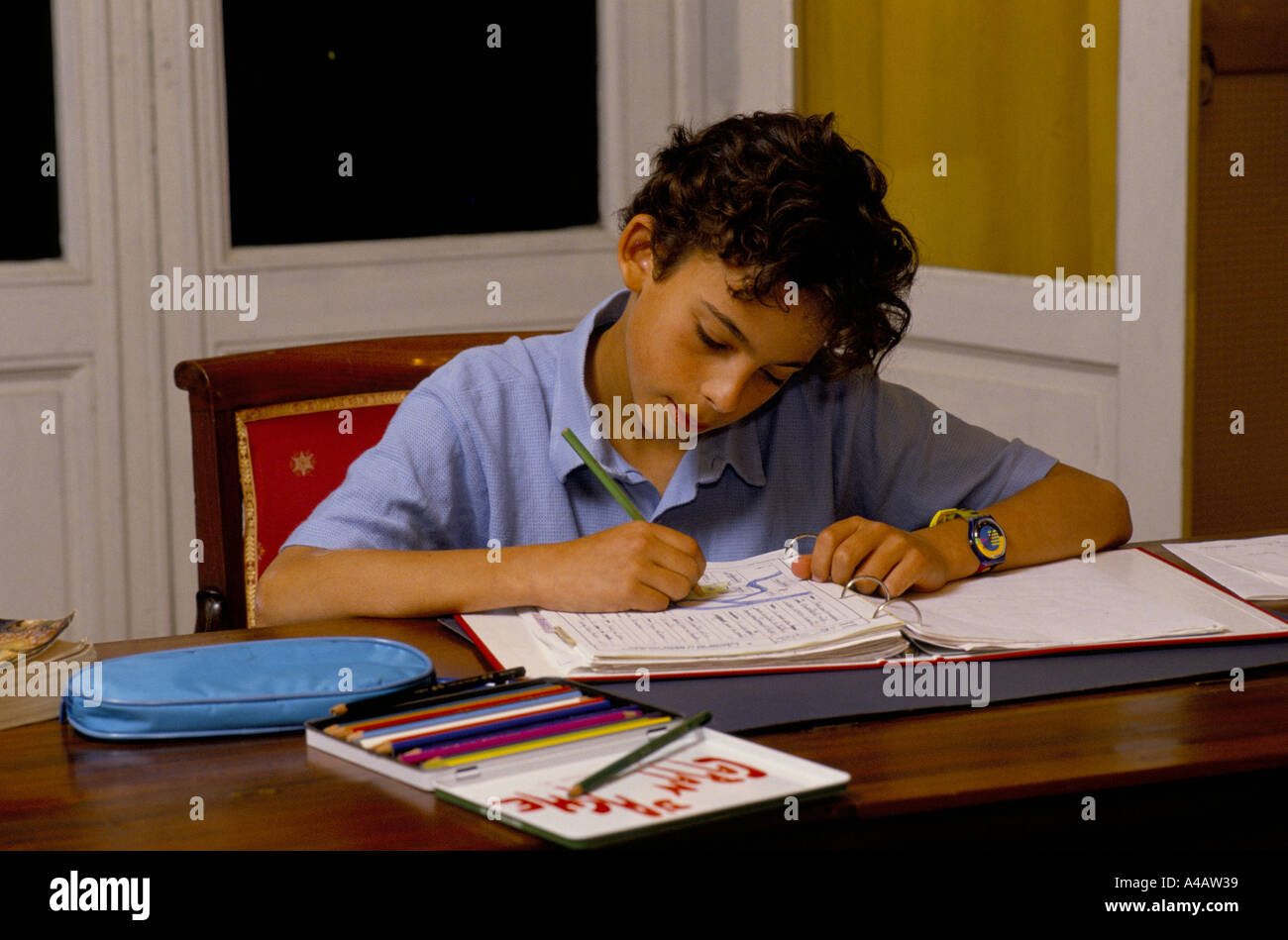 A boy does his school work,Cothill School is a fee-paying private prep school based in Oxfordshire, England - Stock Image