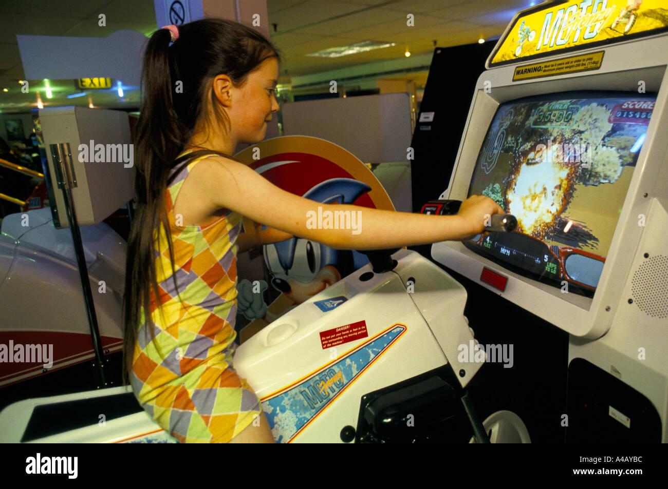young girl on a sega virtual reality motorbkie racing game hamleys toy shop london - Stock Image