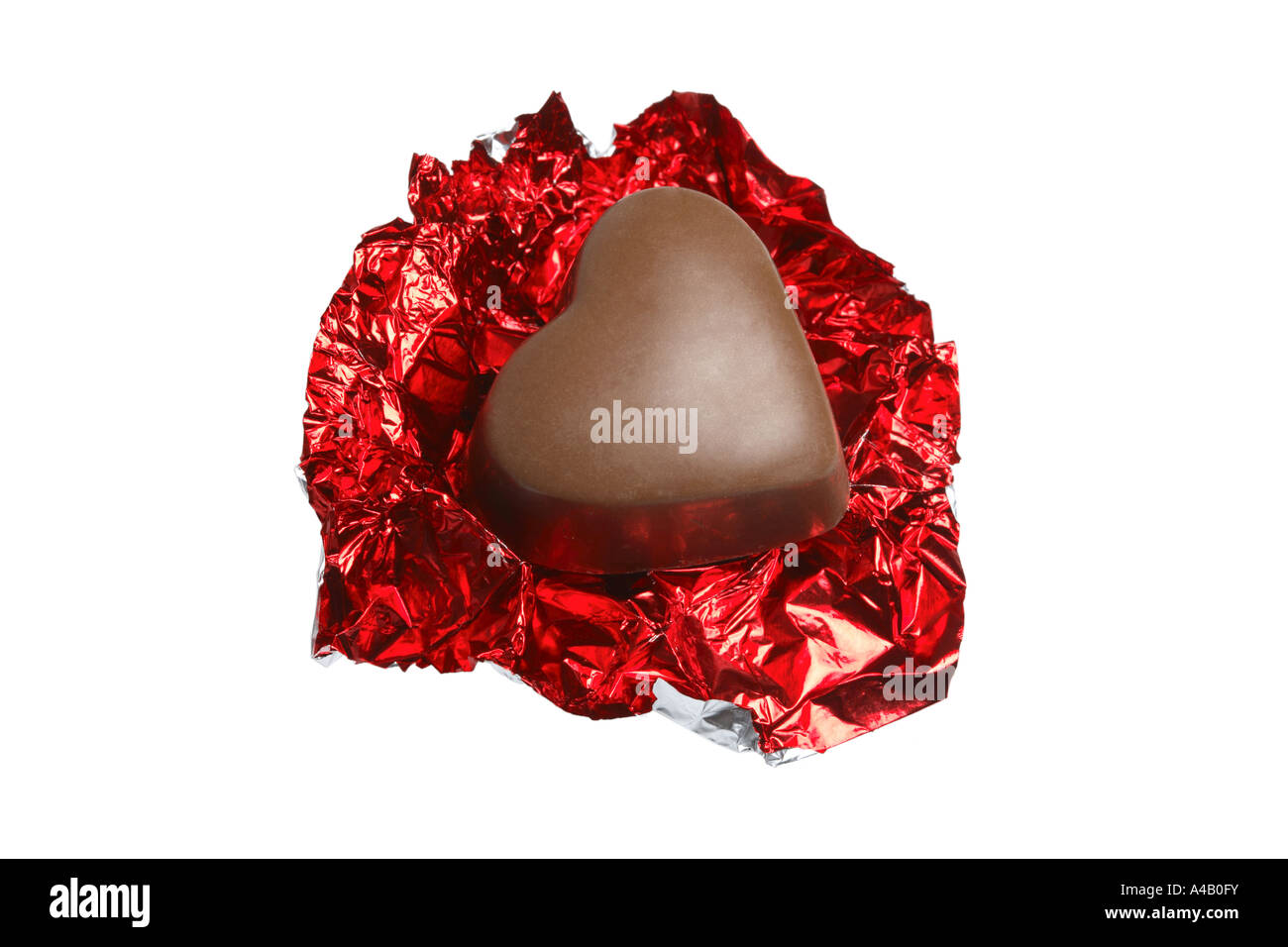 Chocolate Heart with Wrapper cut out on white background - Stock Image