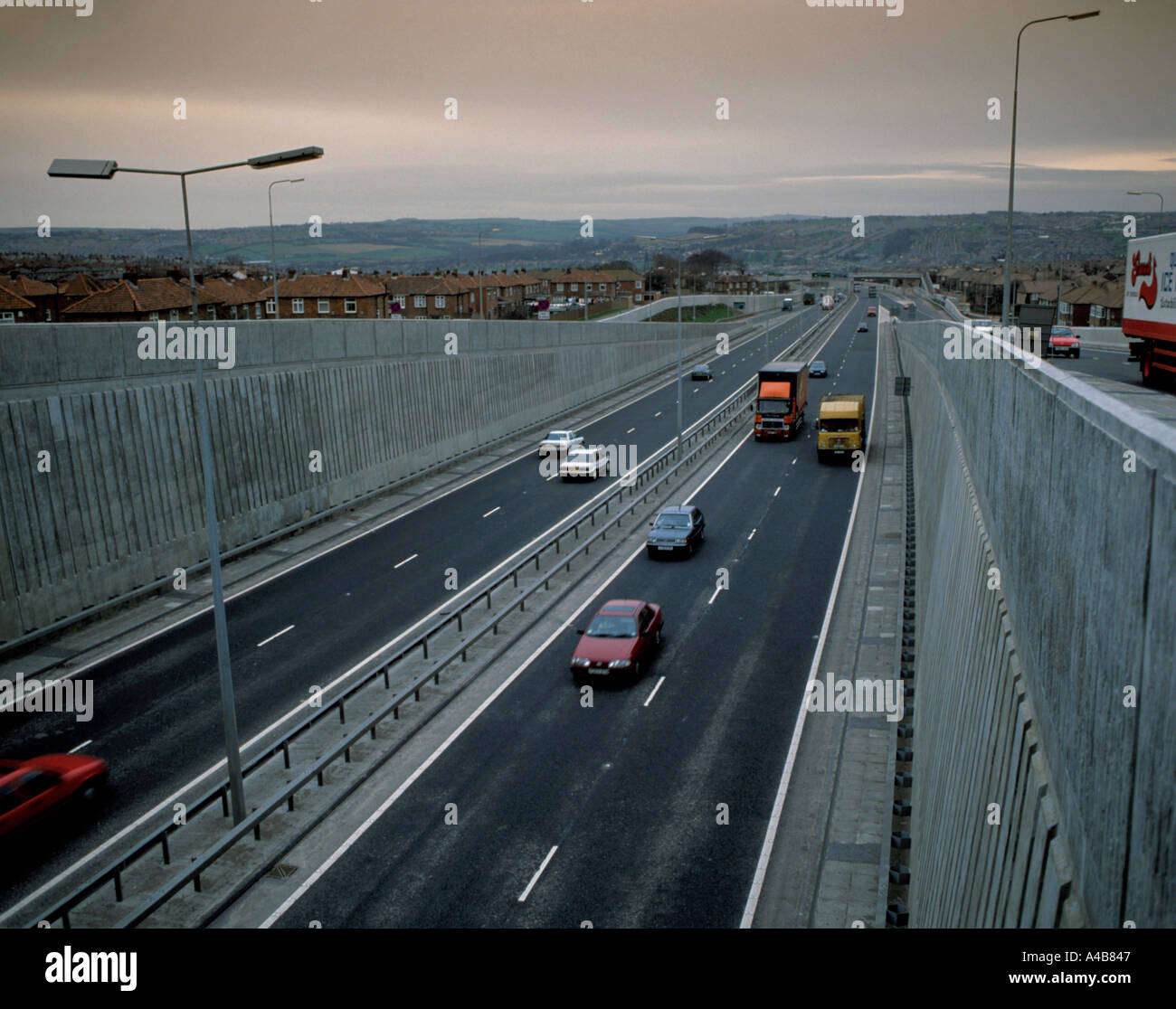Trunk road intersection showing slip roads, concrete retaining walls, noise barriers, etc. Stock Photo