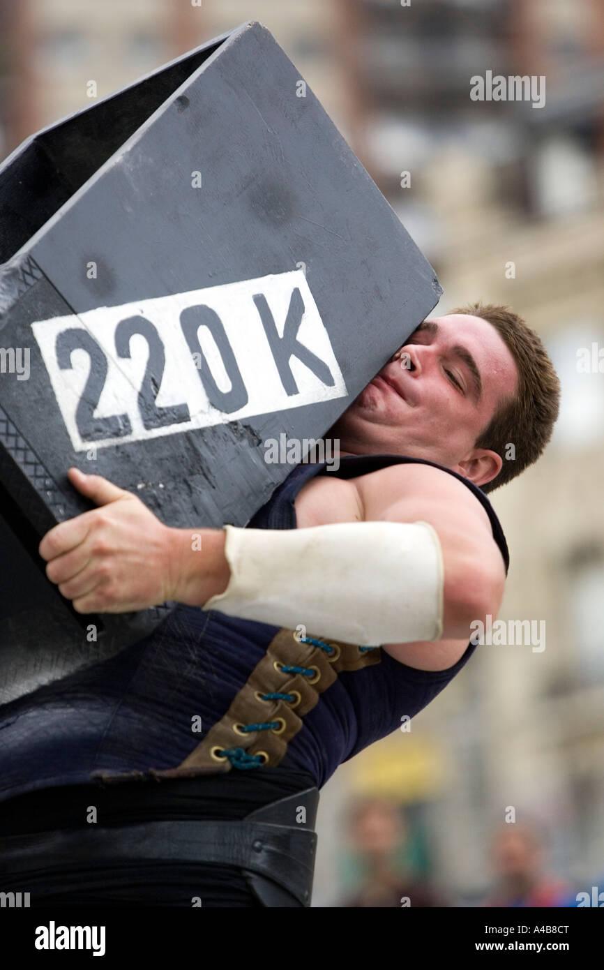 Male harrijasotzaileak (stone lifting) competitor lifting 220 kilo