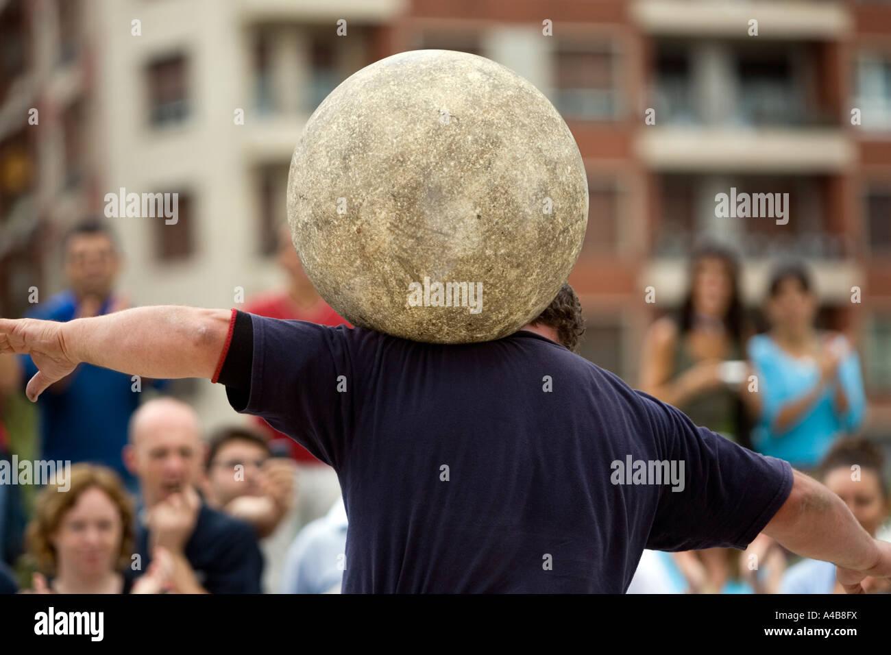 Harrijasotzaileak (stone lifting) competitor carrying granite ball