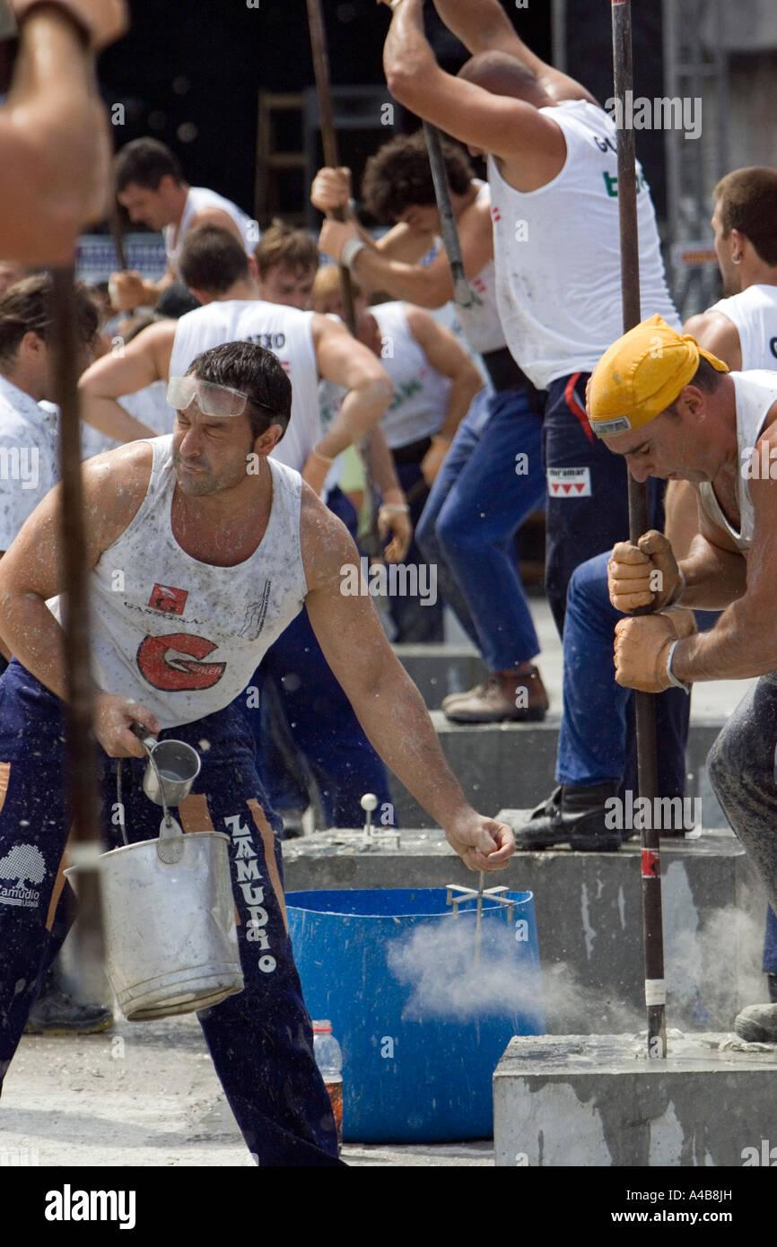 Barrenador (stone drilling) competitors, Basque Strongman Games
