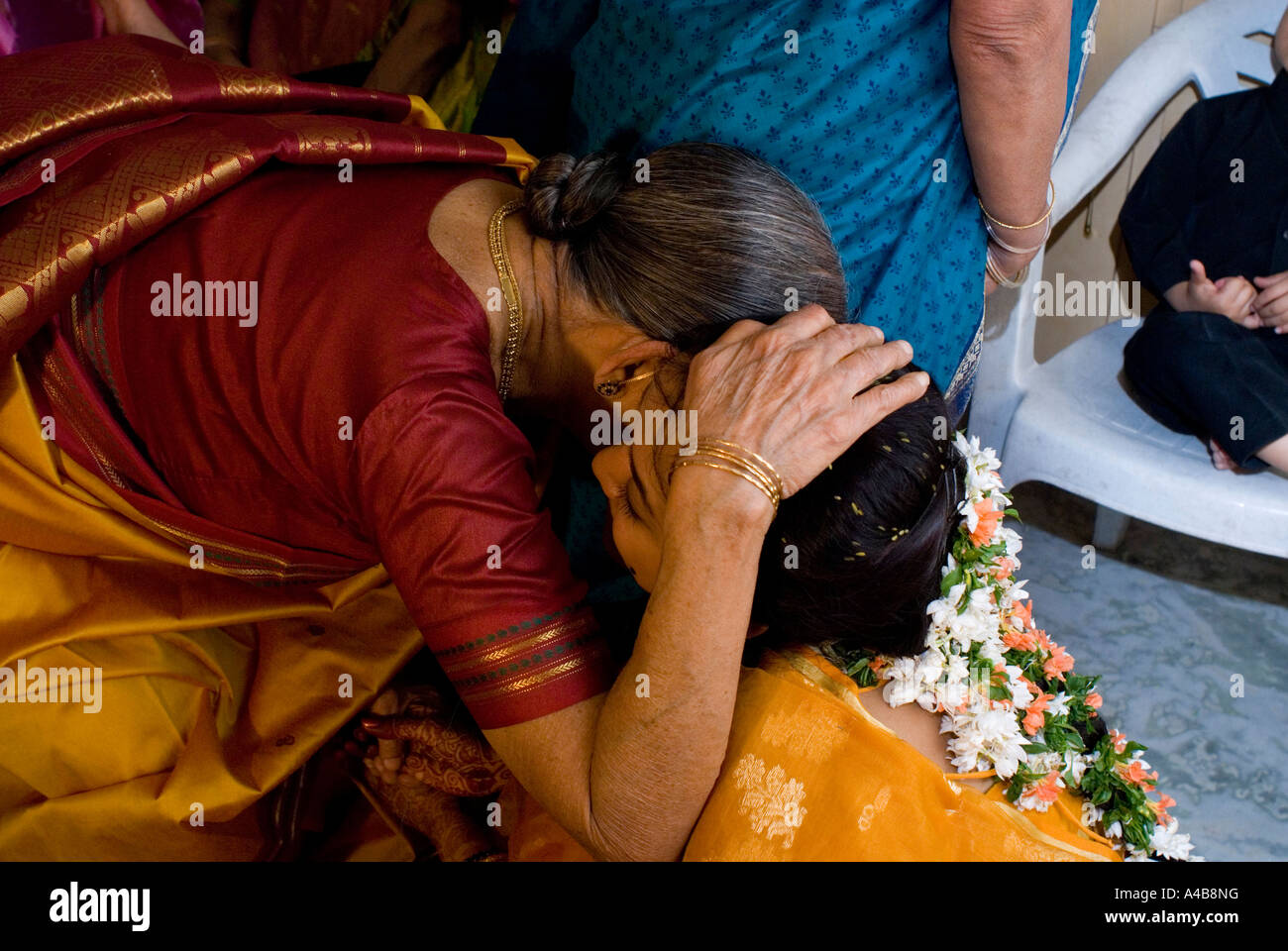 Stock image of traditional Hindu wedding bride receiving blessings from female relatives in Hyderabad India - Stock Image