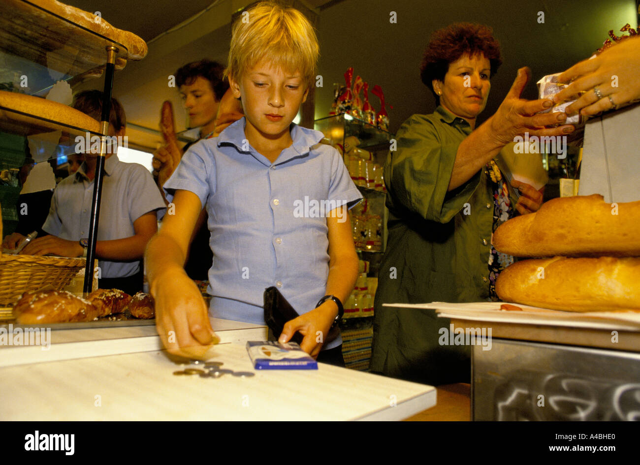 CHILDREN SHOPPING FOR BREAD. The school has an annex at Saveterre Chateau near Toulouse, France - Stock Image
