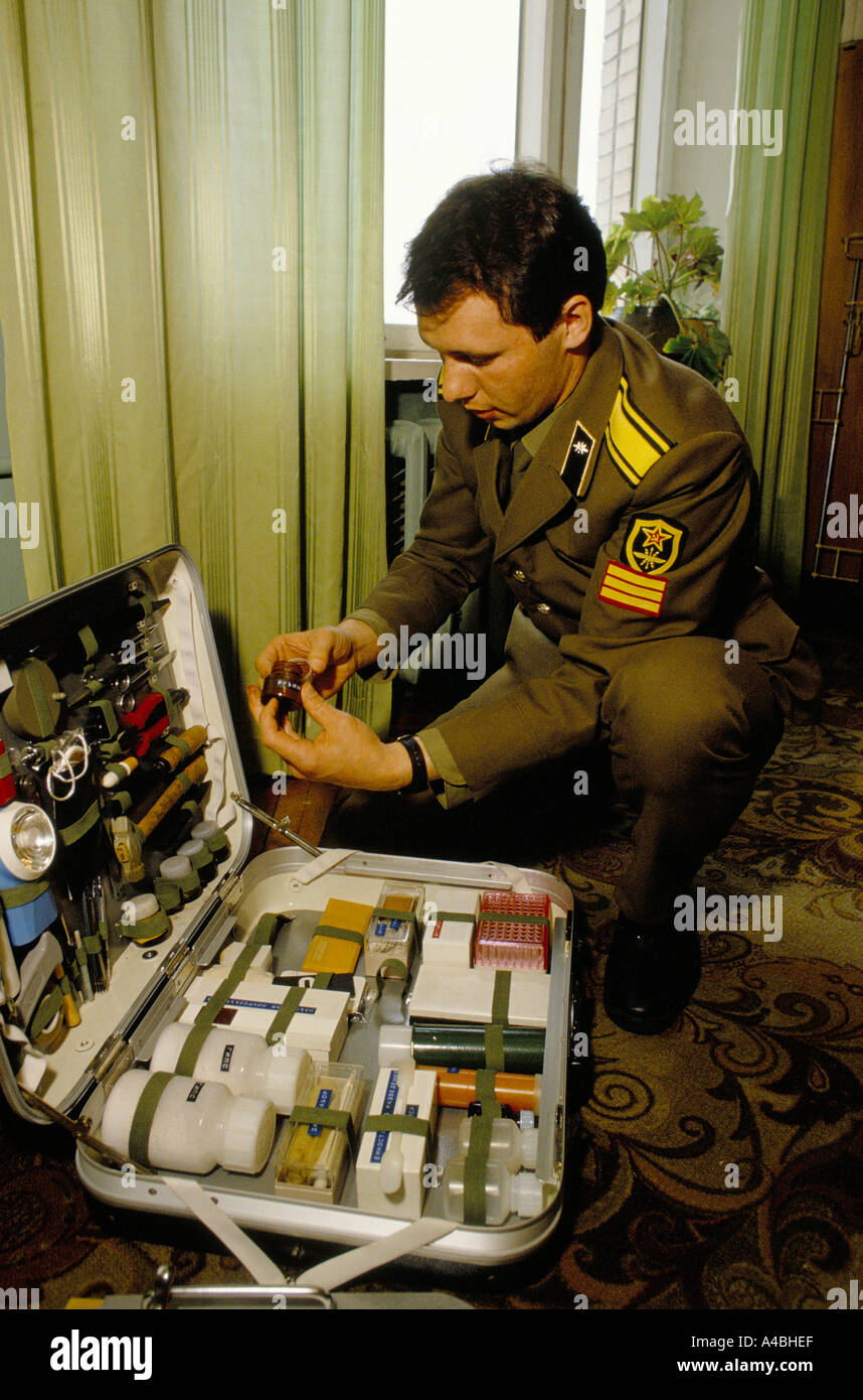 A KGB officer going through the a 'scene of crime' forensic kit at KGB's training school, Moscow, Russia, USSR - Stock Image