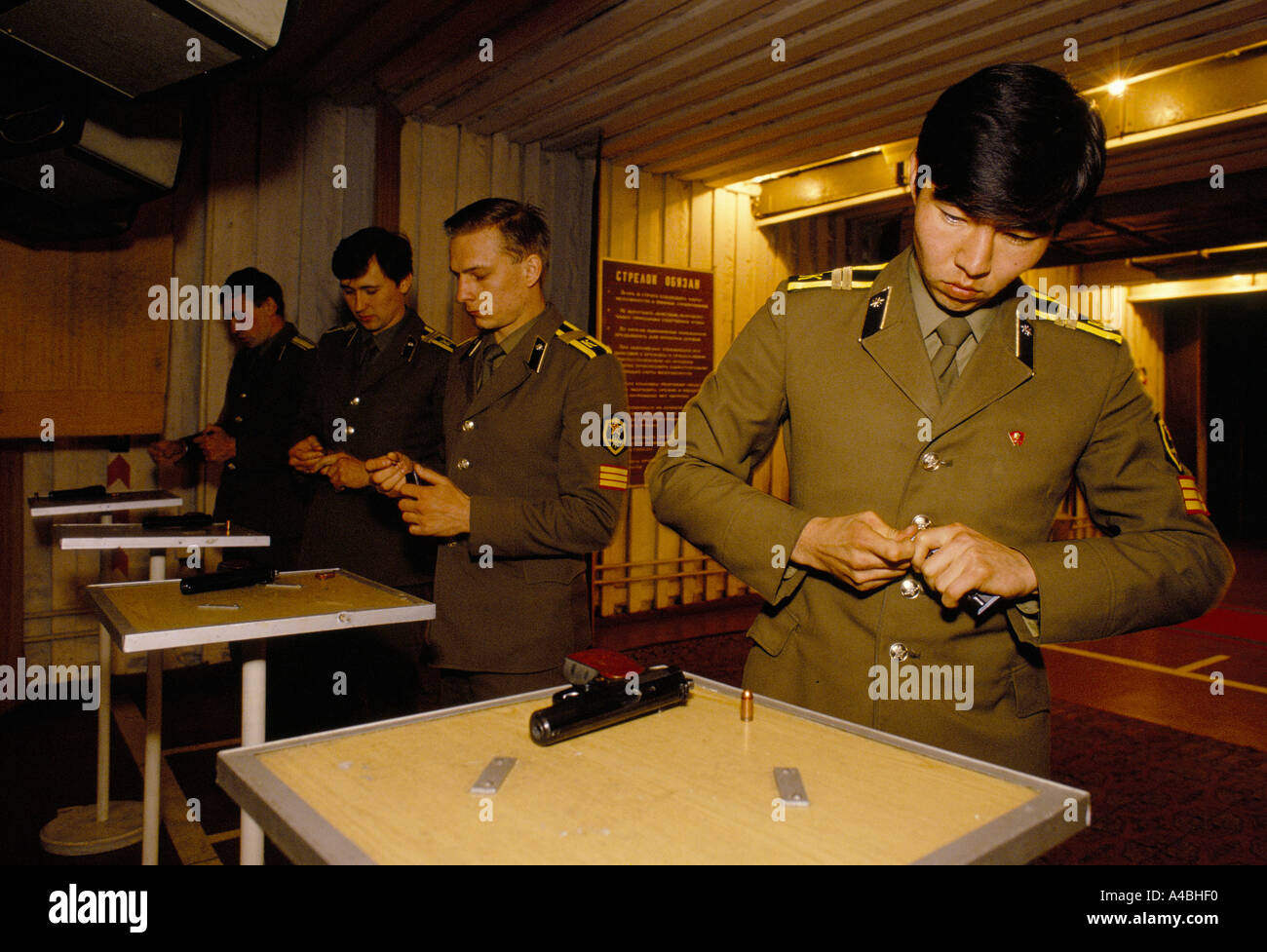 KGB officers load their hand guns in the KGB's training school, Moscow, Russia, USSR, 1990 - Stock Image
