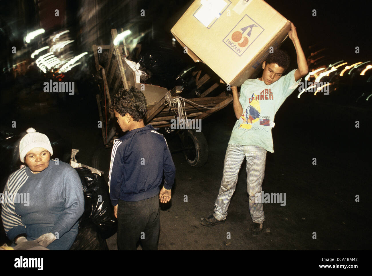 Sao Paulo, Brazil; paper collectors at work at night.  They earn a small wage recycling. - Stock Image