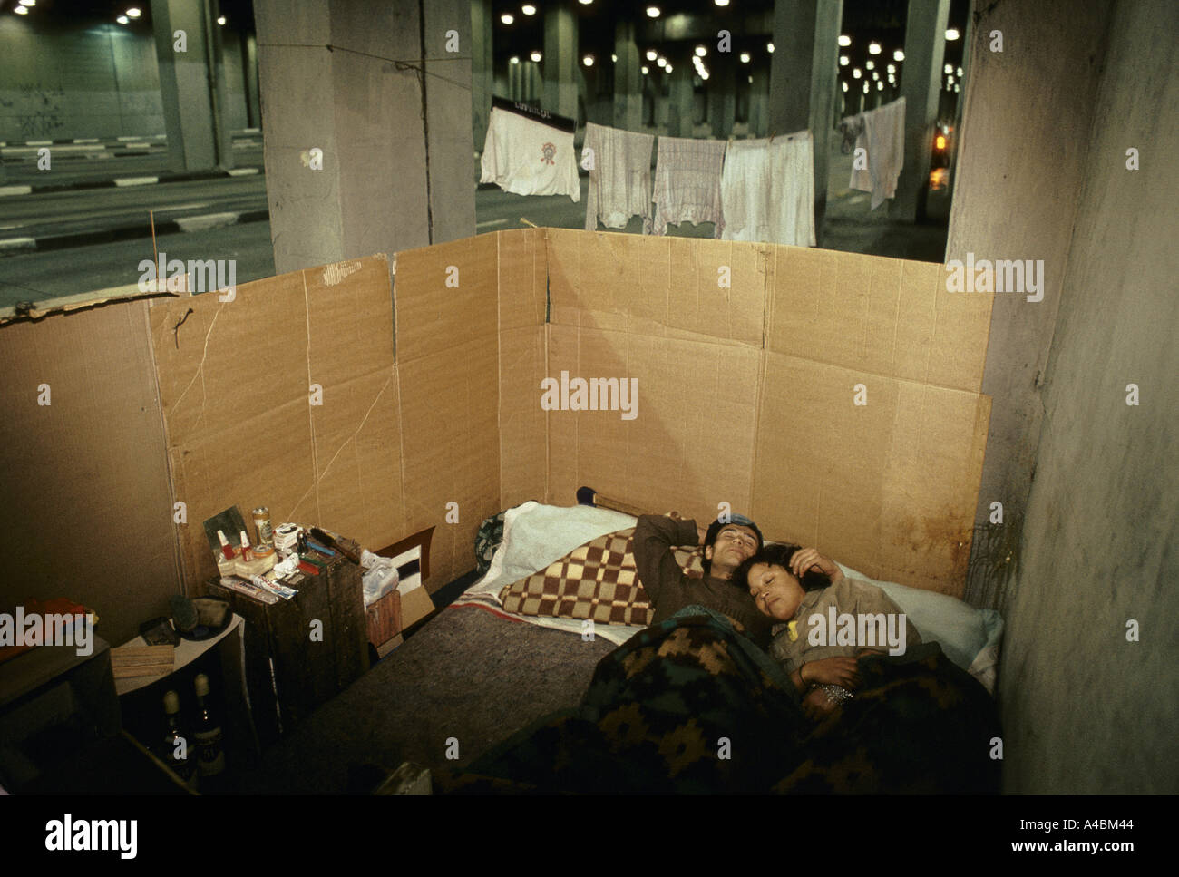 Many homeless like this couple just live on the streets in a cardboard home built beneath a motorway flyover in the heart of Sao Paulo july 1991 - Stock Image