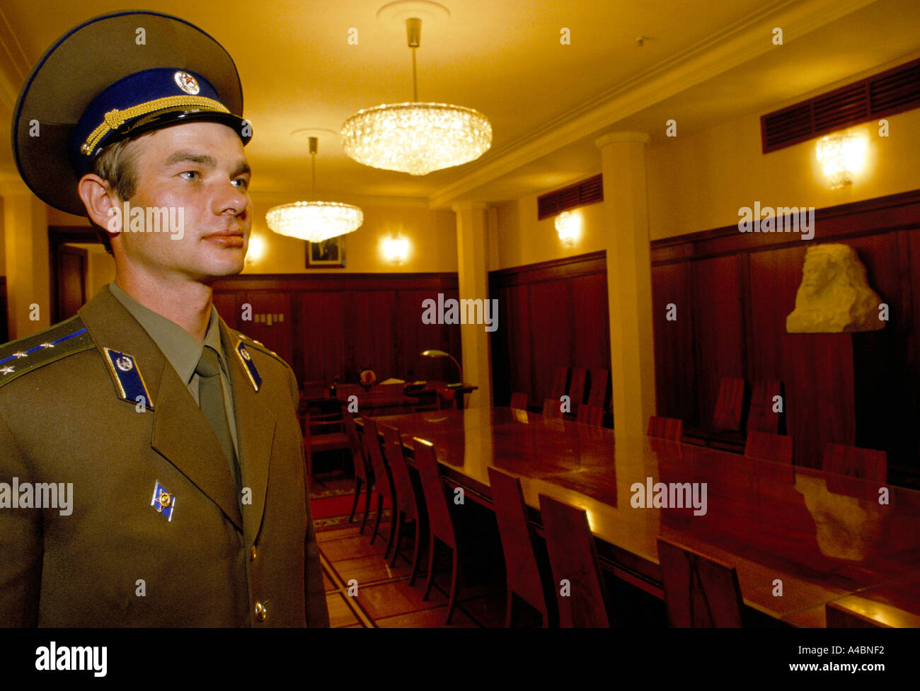 A KGB officer stands in the office of Yuri Adropov in the KGB's headquaters at the Lubyanka building, Moscow Russia 1990 - Stock Image