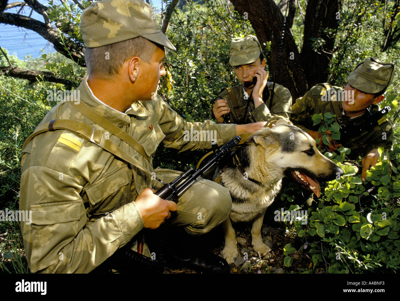 KGB border guards on patrol with their dog in Gursfuv, the Crimea, Russia June 1990 Stock Photo