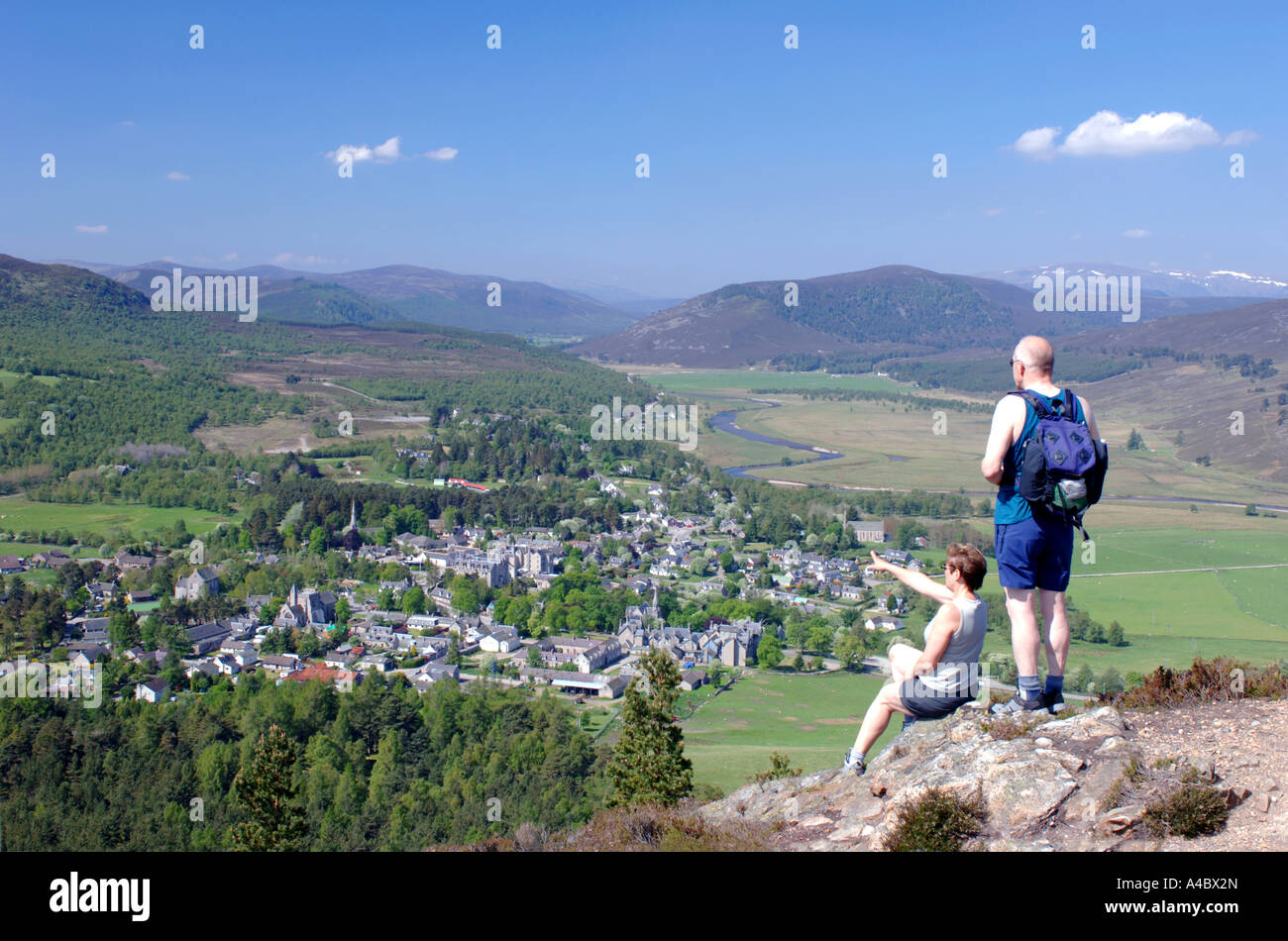 Visitors enjoying the view from the Lion's Crag overlooking Braemar Town.  XPL 4646-437 - Stock Image