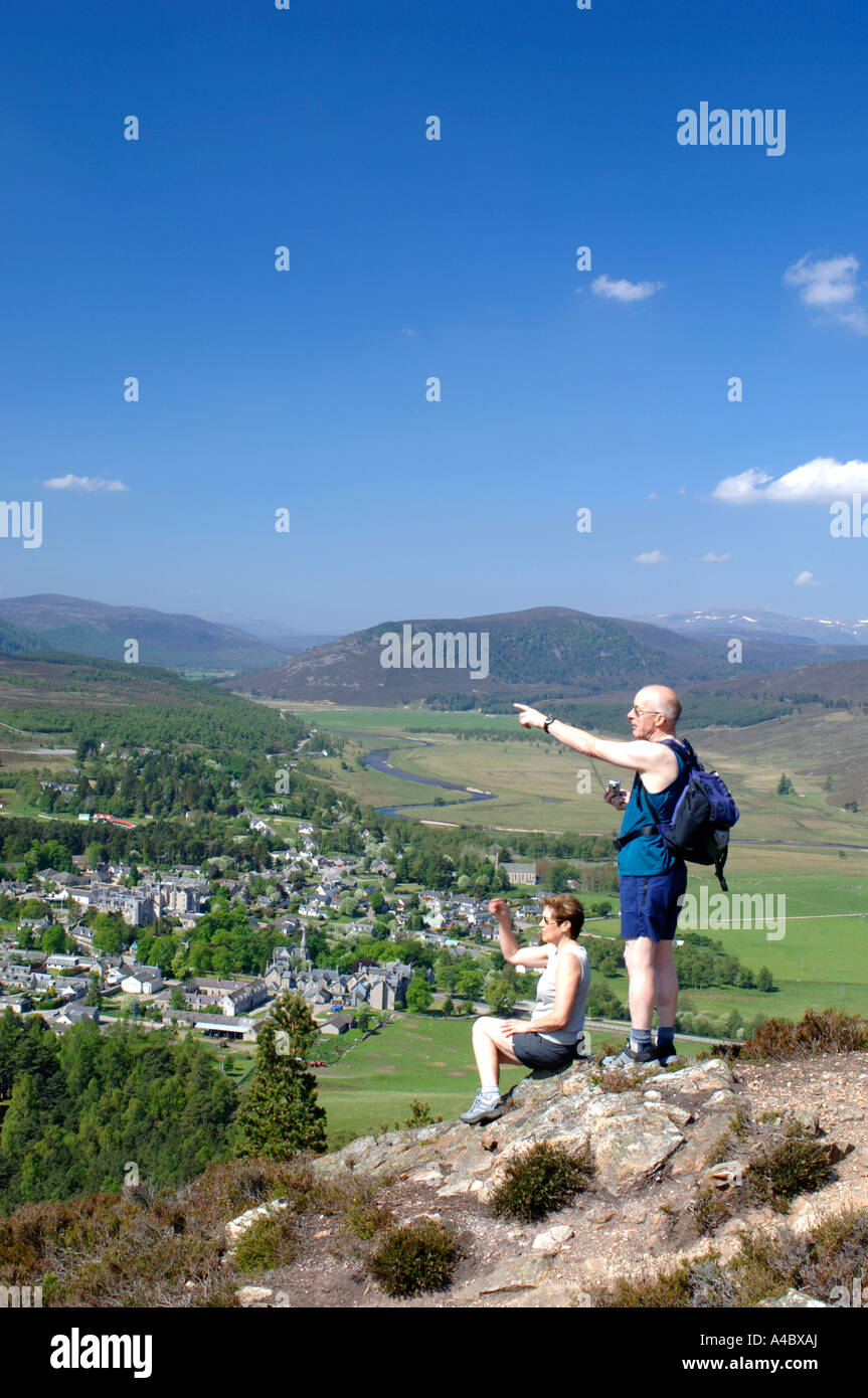 Visitors enjoying the view from the Lion's Crag overlooking Braemar Town.  XPL 4632-436 - Stock Image