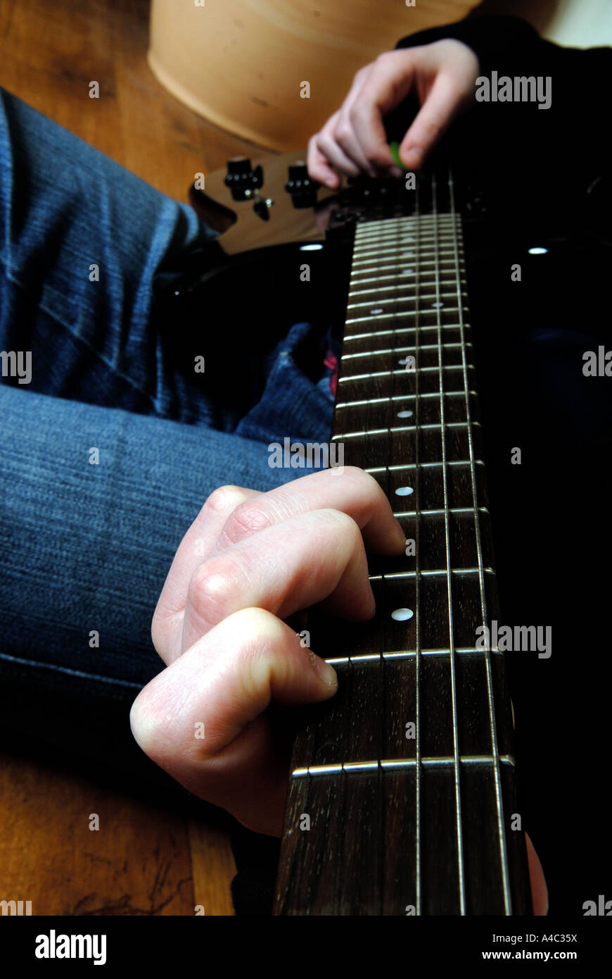Teenager Playing Guitar. - Stock Image