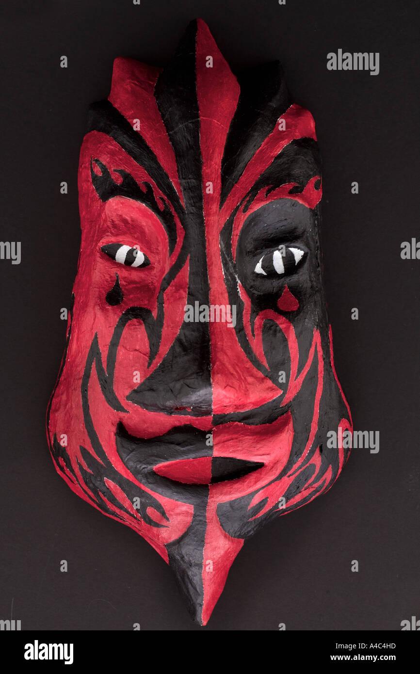 Red Devil Mask on Black - Stock Image