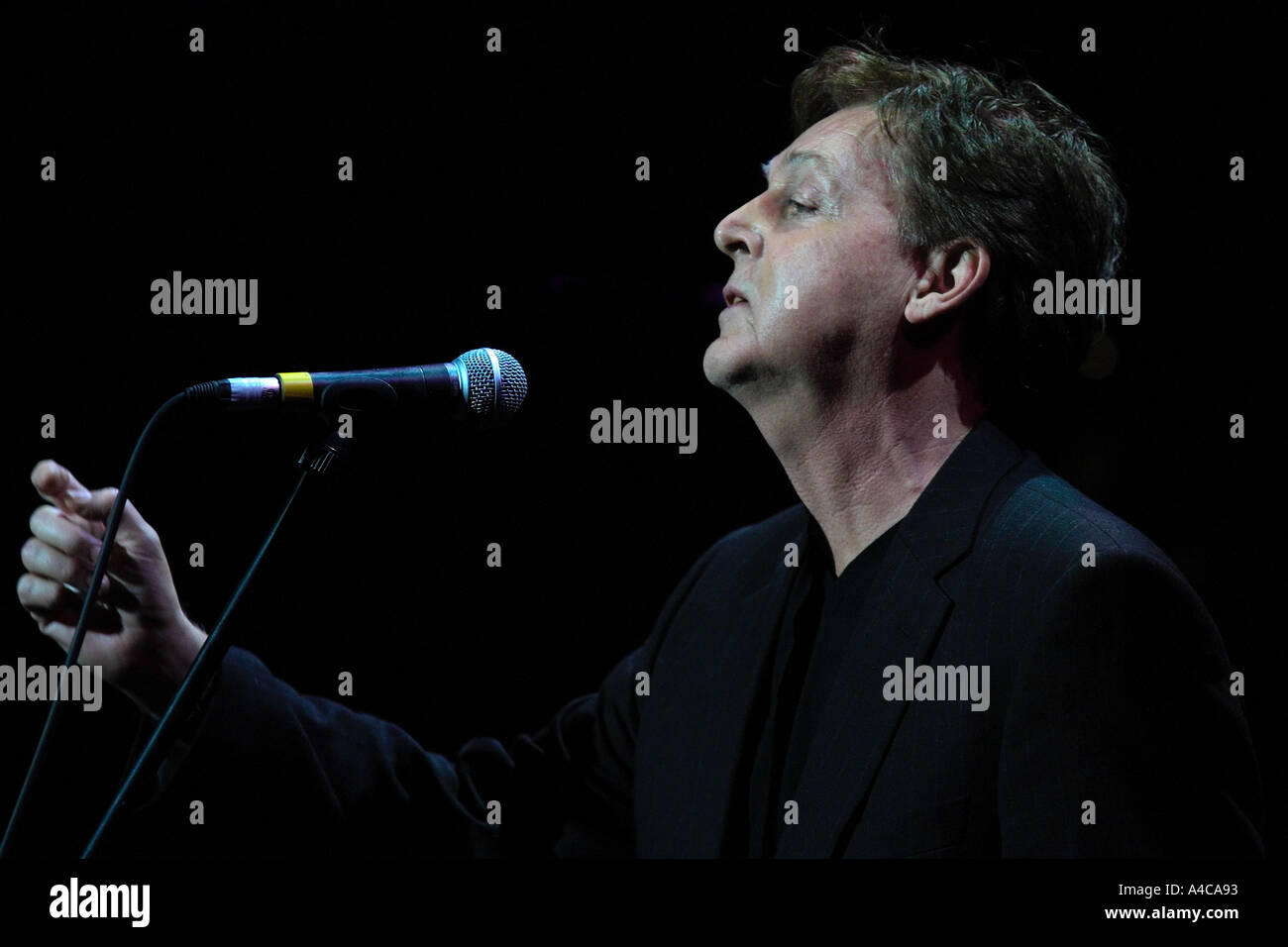 Paul McCartney sings Yesterday as a tribute to George Harrison at a Tribute concert Empire Theatre Liverpool 2002 - Stock Image