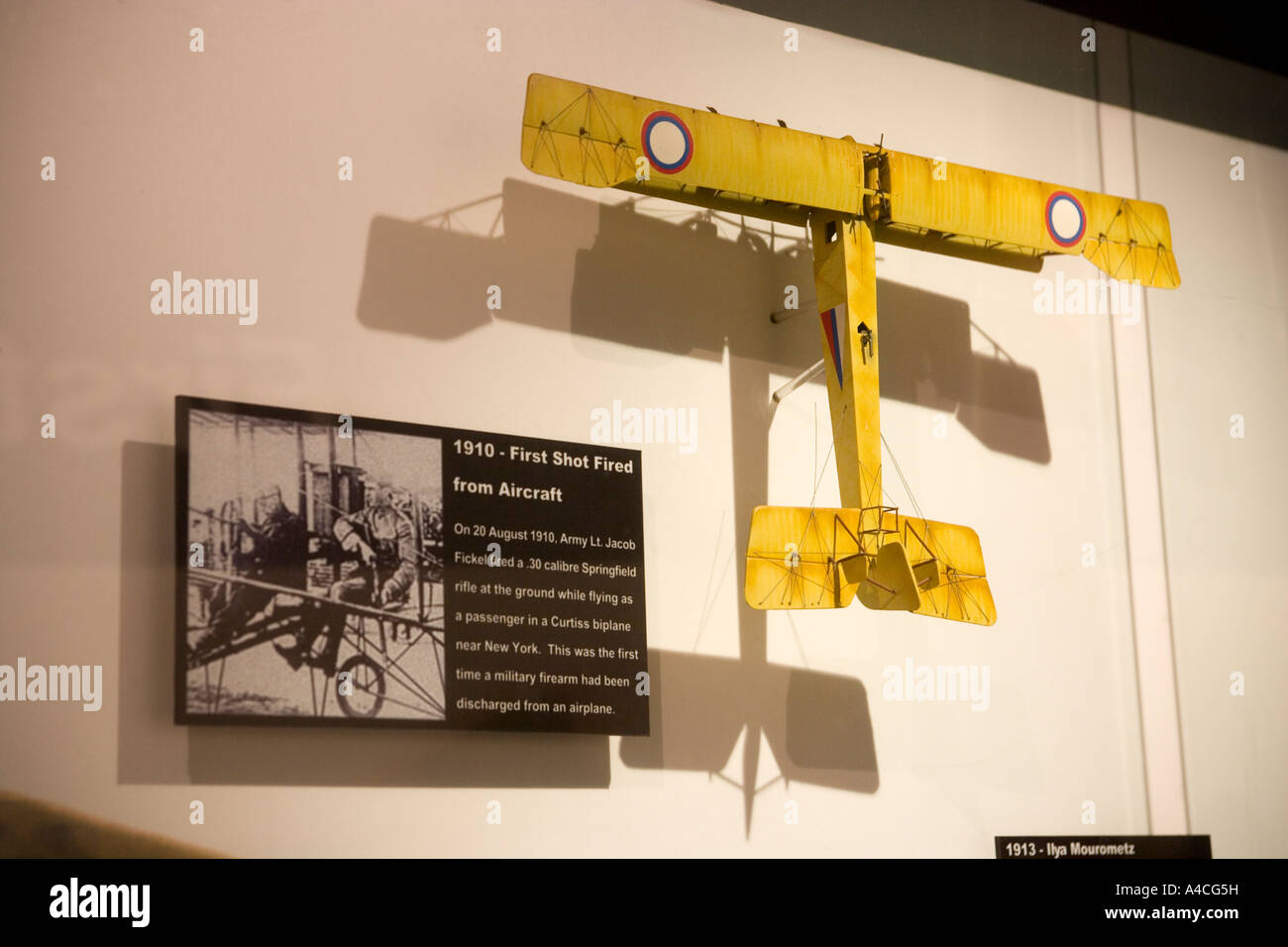 The First Shot Fired from an Aircraft Exhibit Airforce Museum Singapore - Stock Image
