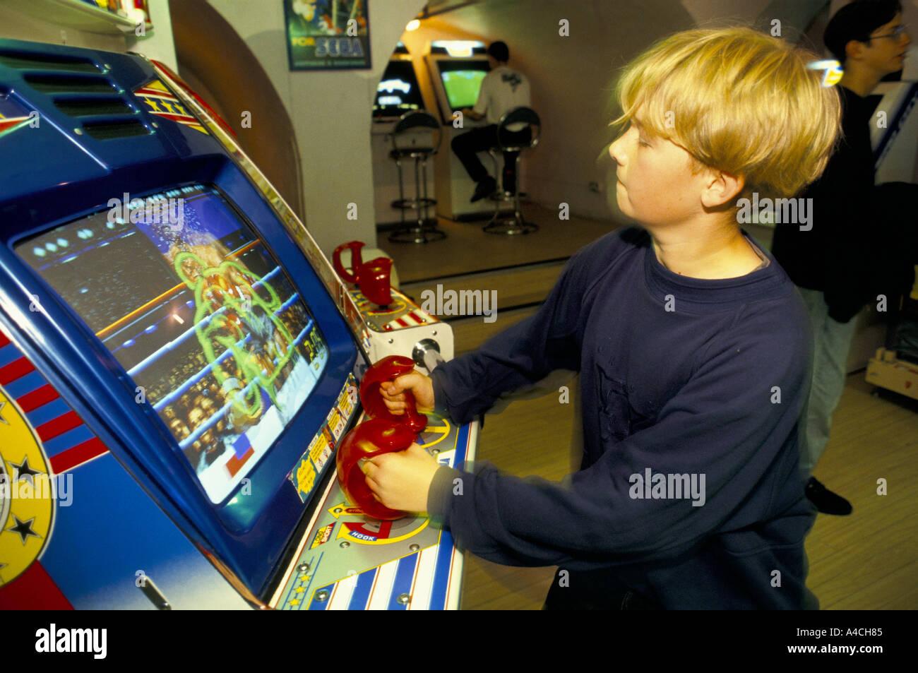 teenaged boy playing sega interactive boxing game hamleys toy shop london 08 93 - Stock Image