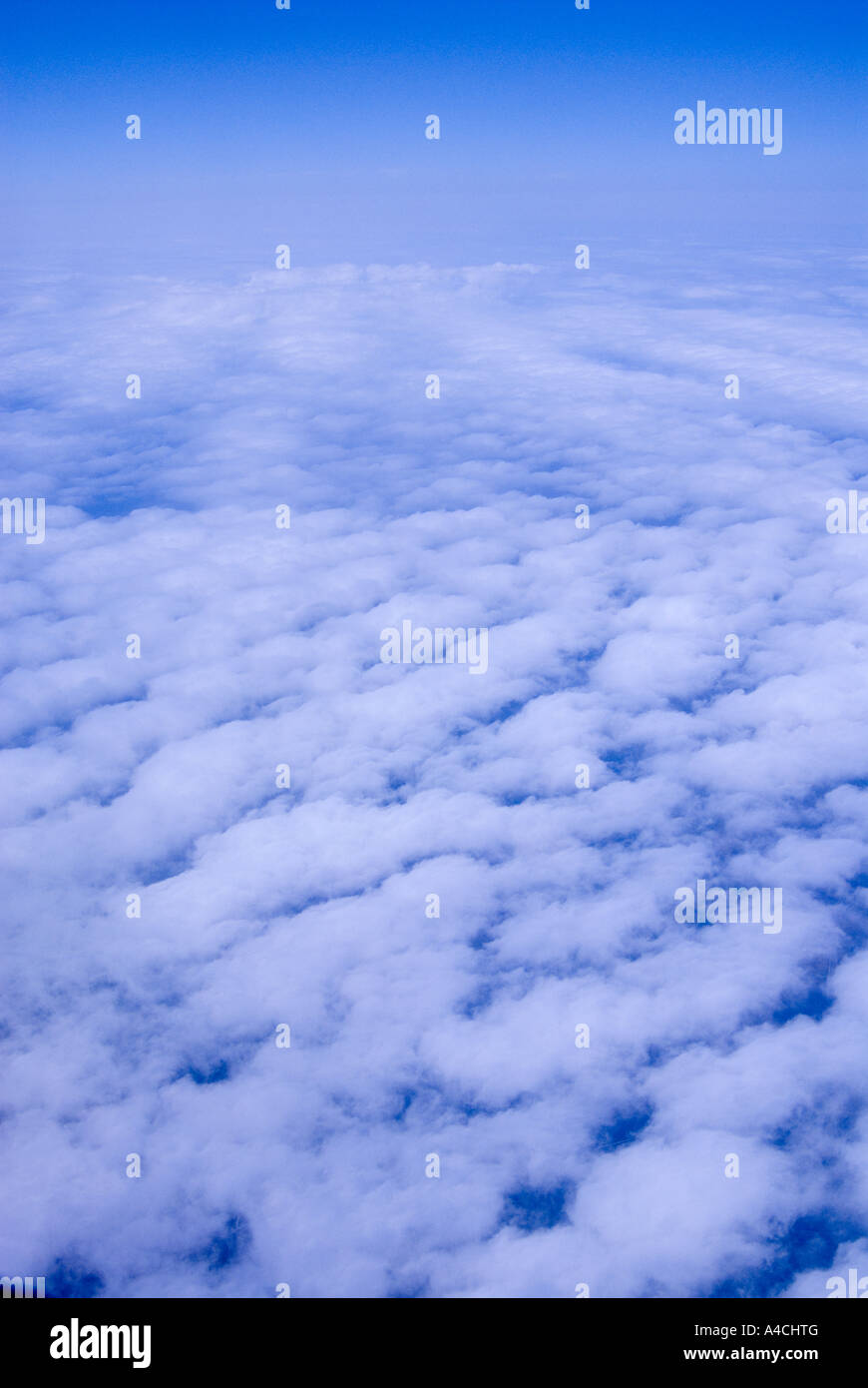 Clouds photographed from a jetliner. - Stock Image
