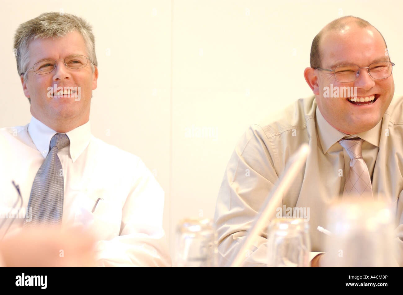 Royalty free photograph of two British businessmen partners in meeting happy about the future UK London - Stock Image