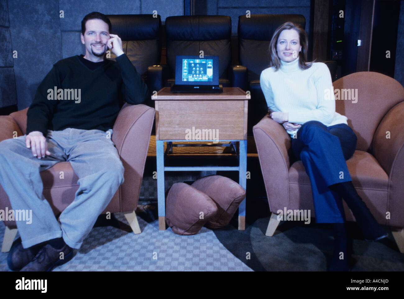 Couple in home theater - Stock Image