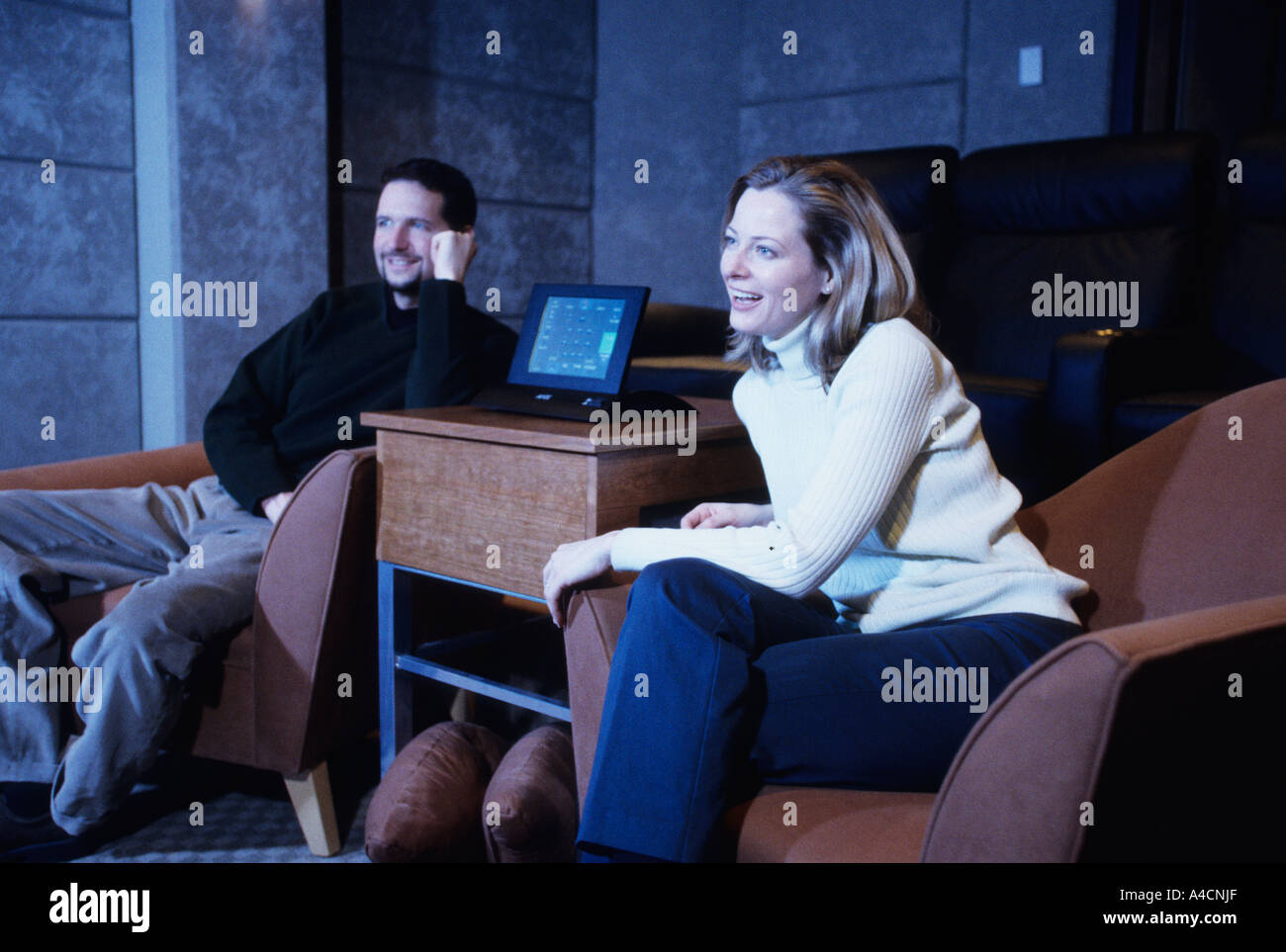 Couple watching home theater - Stock Image