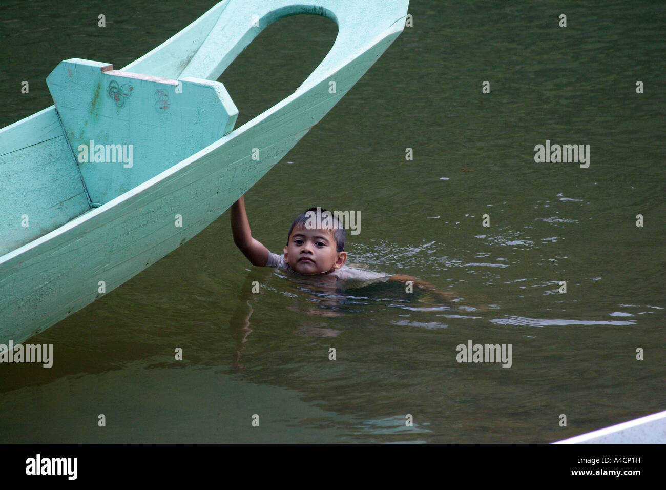 Iban child swimming in the Skrang river at Lalang longhouse, Sarawak Malaysian Borneo - Stock Image