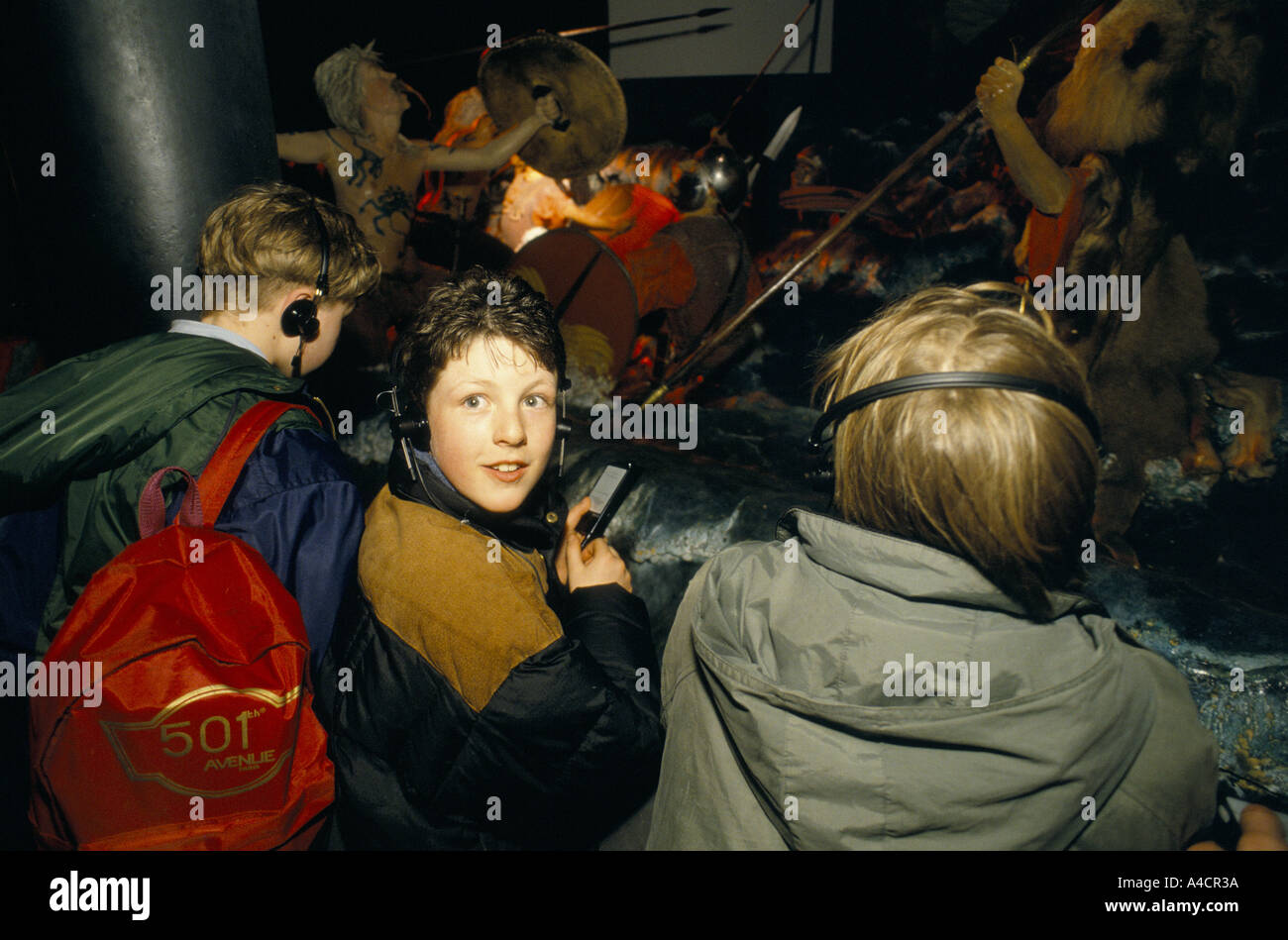 CHILDREN WITH HEADPHONES ENJOYING DISPLAY AT WHITE CLIFFS EXPERIENCE DOVER, ENGLAND, MARCH 1994 - Stock Image