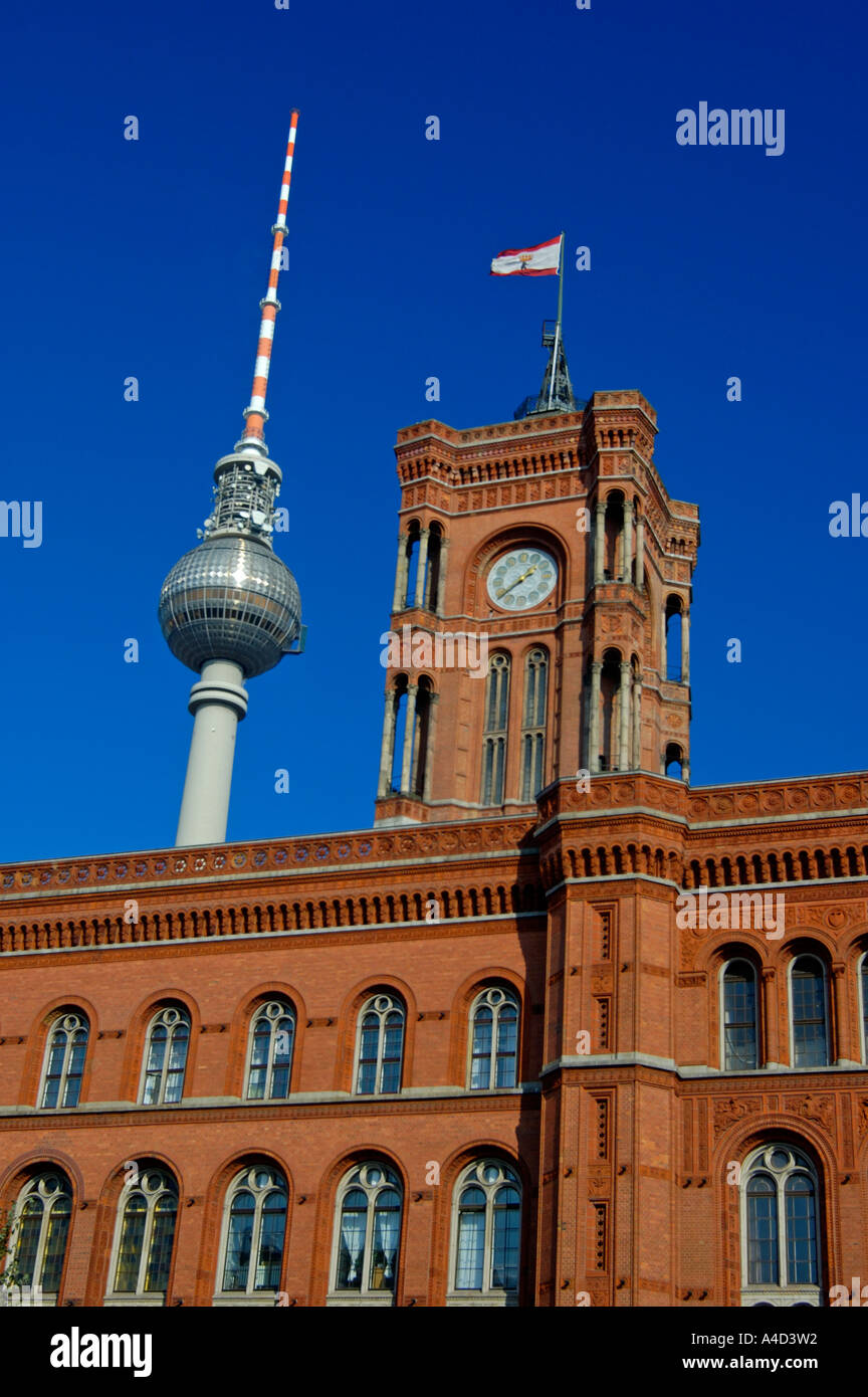 Rotes Rathaus Red Townhall and Fernsehturm TV Tower Alexanderplatz Berlin Germany - Stock Image