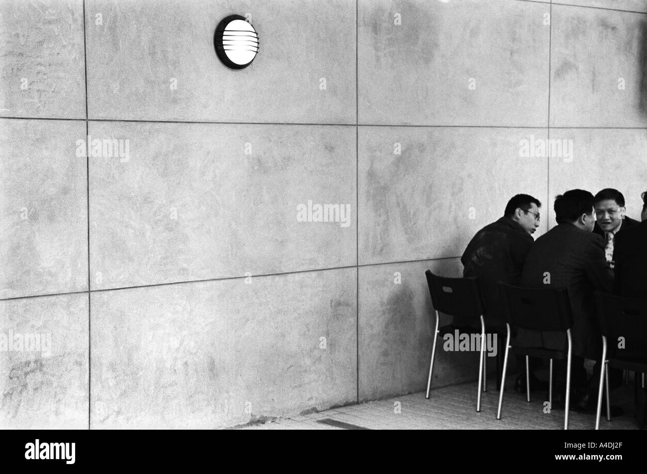 Businessmen in a meeting. Hong Kong, Peoples' Republic of China, HKSAR - Stock Image