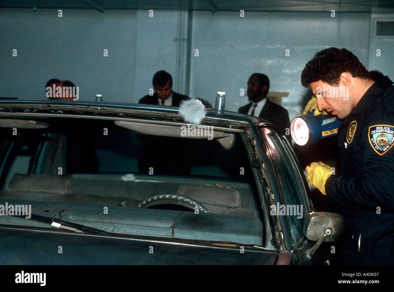 Members of the NYPD Crime Scene Unit investigate the automobile used by Rashid Baz to shoot a van load of yeshiva students on the Brooklyn Bridge - Stock Image