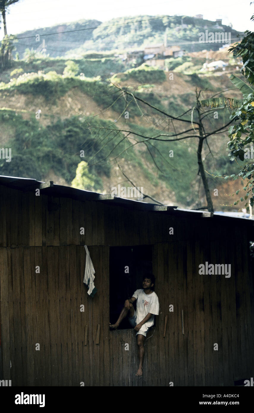A man sits in the window of his wooden house mount diwata mindanao the philippines