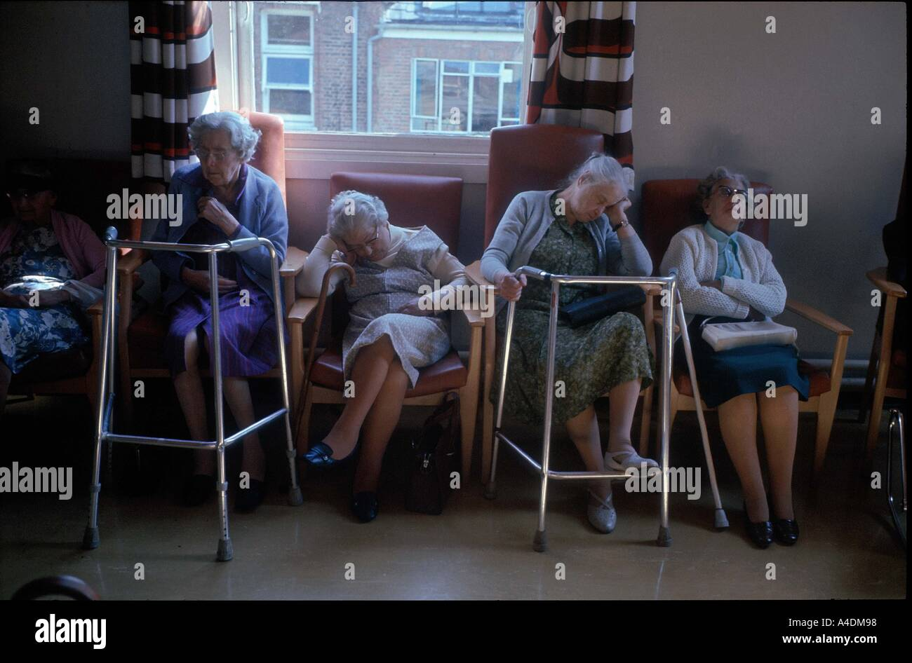 Elderly Women Asleep In Their Armchairs With Their Zimmer Frames And