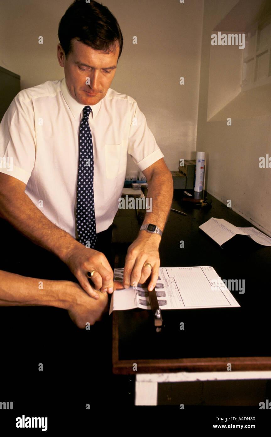 Taking fingerprints at Southampton police station, Southampton, United Kingdom - Stock Image