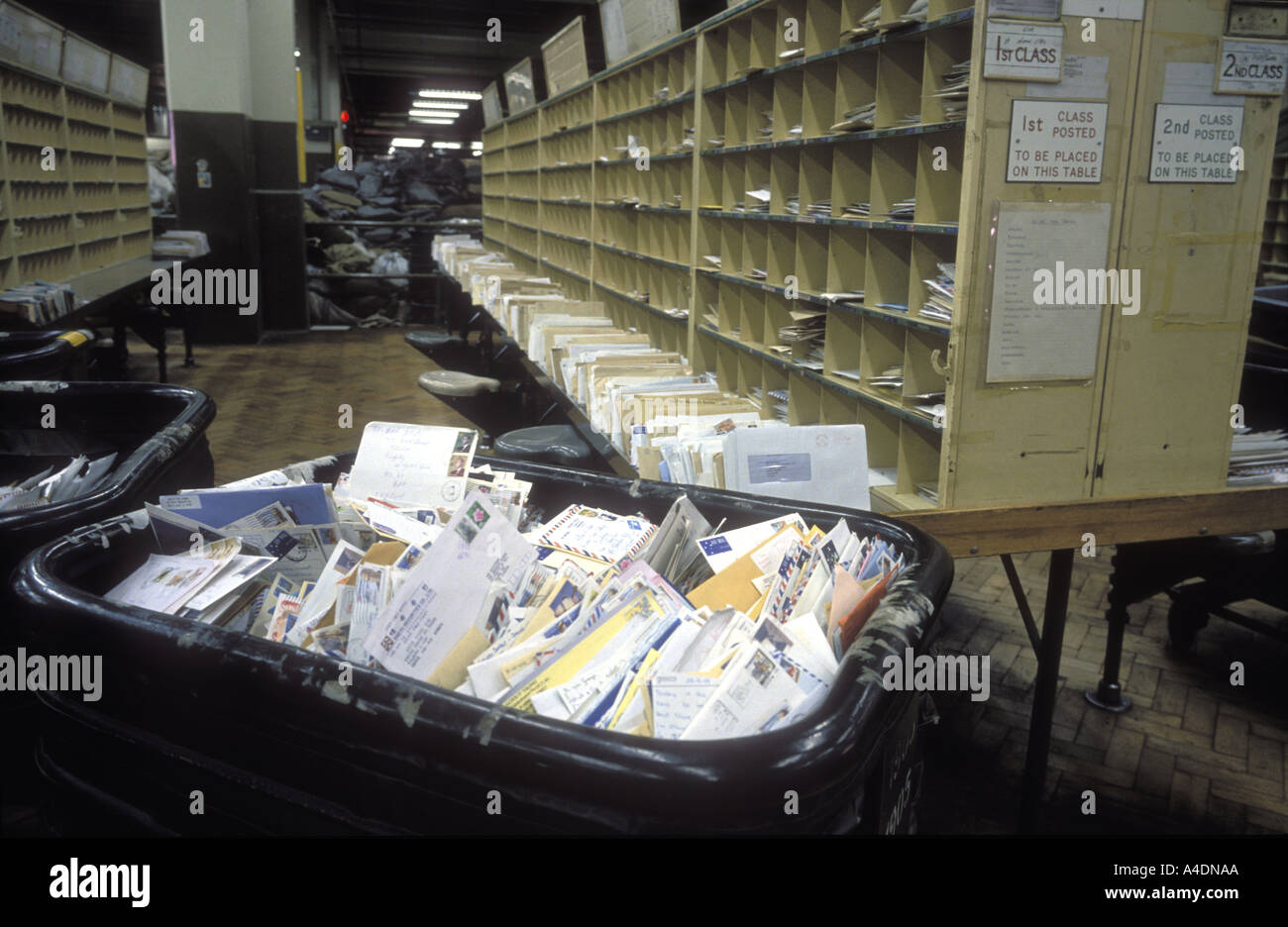 Postal dispute, no staff, but lots of post in a sorting office in 1988, United Kingdom Stock Photo